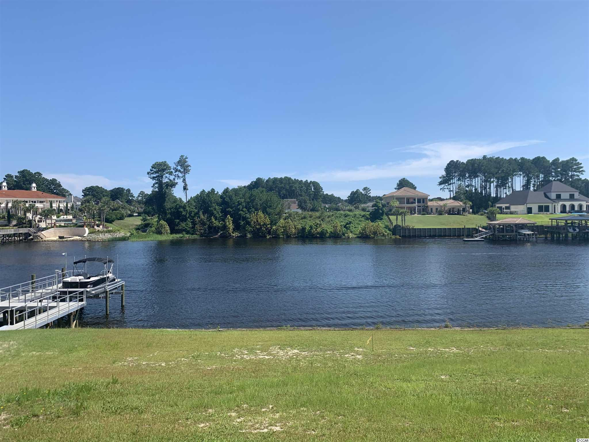 Start living your dream today. This beautiful large waterway lot that is ready for you to build your dream house. Choose your own builder and no time frame to build.   This lot is located in the highly desired gated Carolina Waterway Plantation. Resort style amenities include: furnished clubhouse with kitchen and banquet room, outside grill, pool, kids playground, gazebo, tennis court, walking trails, boat ramp, storage for RV and boats.   Carolina Forest area offers award-winning schools, grocery stores, medical facilities, recreational  centers, library ,religious centers, bike park.   Don't hesitate!! Start experiencing and relaxing natures beauty with extraordinary sunrises and water views in Carolina Waterway Plantation.
