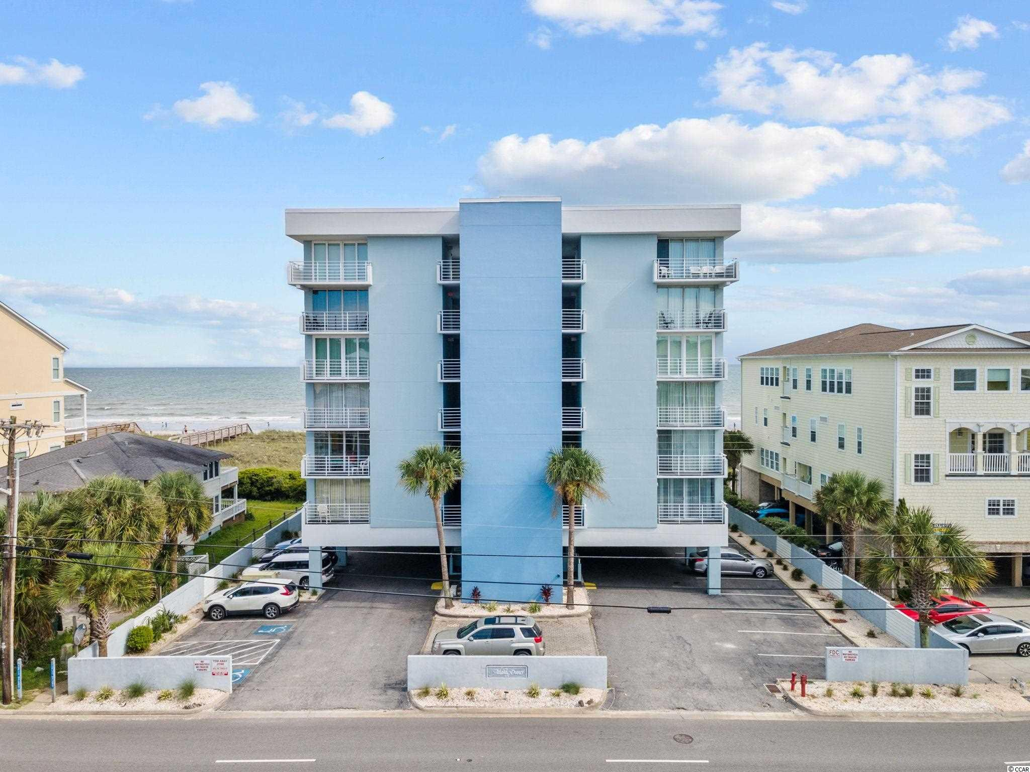 Don't miss this chance at owning a GREAT 4 bedroom, direct oceanfront condo in a quaint, boutique building in the heart of North Myrtle Beach.  This spacious condo features tile flooring in living areas, granite countertops and stainless steel appliances in the kitchen and an oceanfront master suite with private balcony access.  The second master suite features a private balcony overlooking the street side.  The large oceanfront balcony offers vast views of the ocean and at only one story up, makes you fell like you are sitting right on the beach.  Atlantic Dunes is one of those buildings that units do not come up for sale that often...and when they do, they go quick.  There's parking under the building as well as overflow parking across the street.  There's a large oceanfront pool and access to the beach.