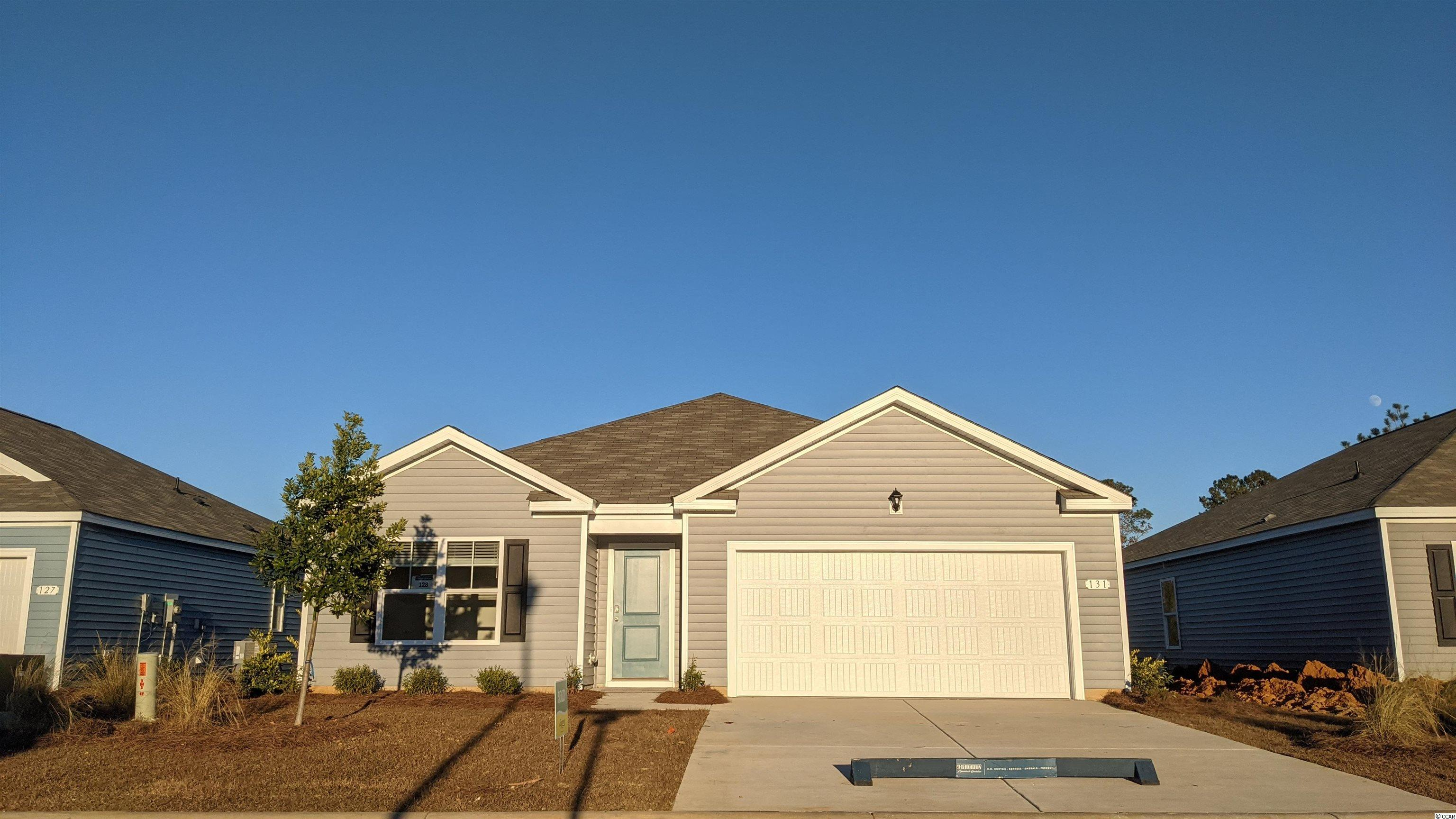 """Brand new community at the edge of Conway/Aynor.   Our Cali plan is a thoughtfully designed one level home with a beautiful, open concept living area that is perfect for entertaining. The kitchen features granite countertops, an oversized island, 36"""" painted cabinetry, a walk-in pantry, and stainless Whirlpool appliances including a side-by-side refrigerator. The large owner's suite is tucked away at the back of the home, separated from the other bedrooms, with a walk-in closet and spacious en suite bath with a double vanity, 5' shower, and separate linen closet. Low maintenance laminate flooring in the main areas gives the look of wood with easy care and cleanup! Spacious covered rear porch adds additional outdoor living space. 2 inch faux wood blinds included on all standard windows.  This is America's Smart Home! Each of our homes comes with an industry leading smart home package that will allow you to control the thermostat, front door light and lock, and video doorbell from your smartphone or with voice commands to Alexa. *Photos are of a similar Cali home.  (Home and community information, including pricing, included features, terms, availability and amenities, are subject to change prior to sale at any time without notice or obligation. Square footages are approximate. Pictures, photographs, colors, features, and sizes are for illustration purposes only and will vary from the homes as built. Equal housing opportunity builder.)"""