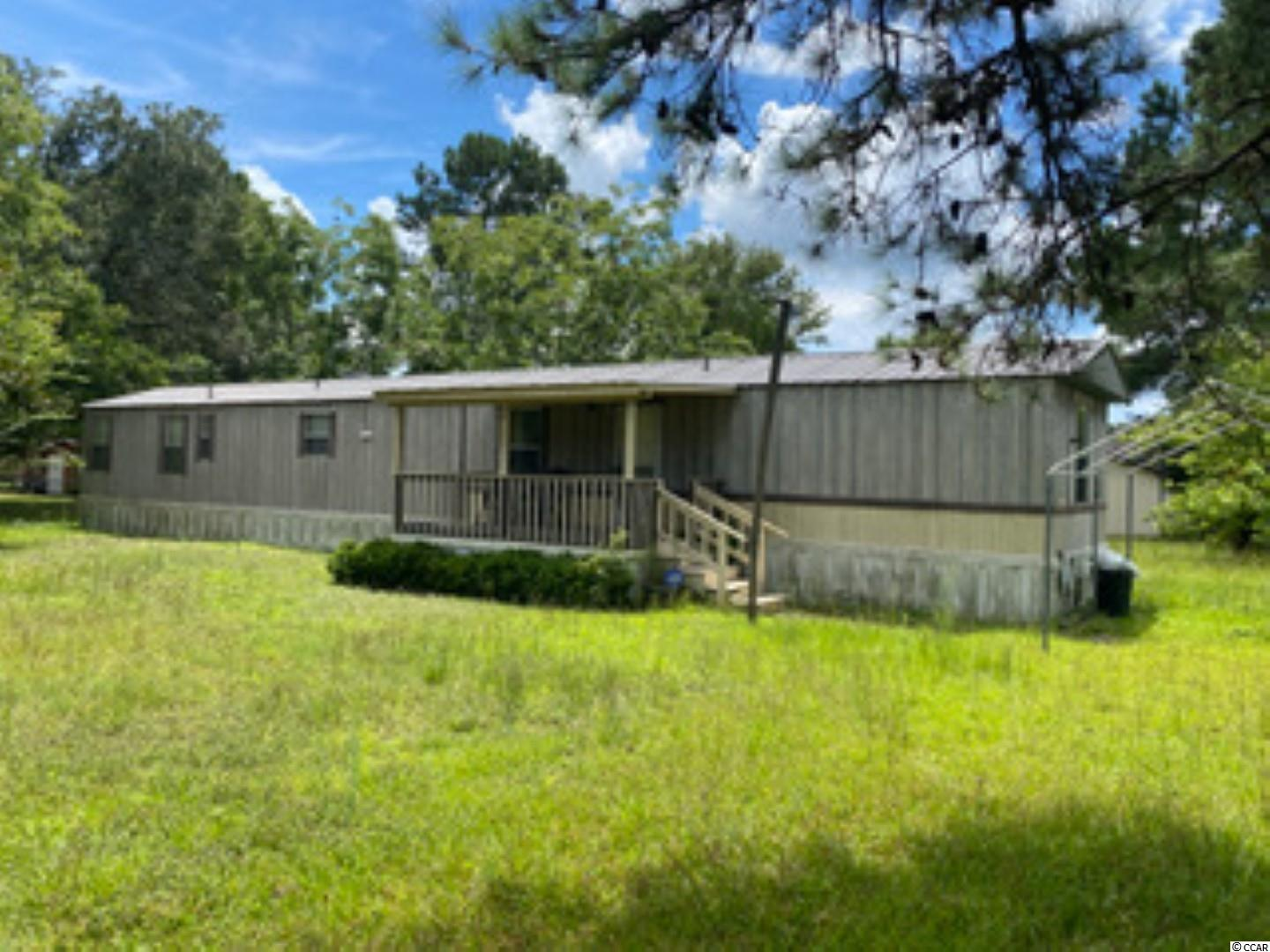 """Great two bedroom, two bath single wide on .35 ac. lot. The entire property is fenced in. There is a large storage shed out back to make your own. There are some repairs needed. Property is being sold 'AS IS""""."""