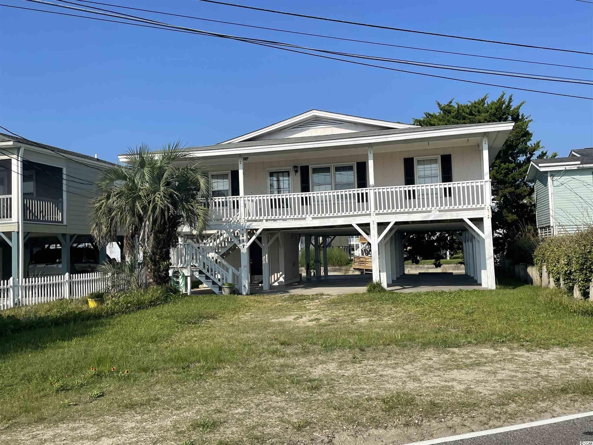 """Welcome to Cherry Gove.  This is a one of a kind location in the very desirable area of Cherry Grove.    Once you are here at your 4br/2ba home at the beach, you will be able to enjoy water views off of your back deck, or sit on your front porch and take in panoramic views of the Cherry Gove marsh.     There aren't many opportunities that come along where you have water in front and behind a home.     This is an opportunity for you to come in an make this home your own.    This home is being sold """"as is"""" and the current owner welcomes all inspections.    You will be able to take a short walk to the best beaches along the North Myrtle Beach coastline, a short drive to grocery stores, restaurants, and shopping, all while being able to take in gorgeous scenery.   If you are looking for the perfect place to call home here at the beach, and make it your own, this is it."""