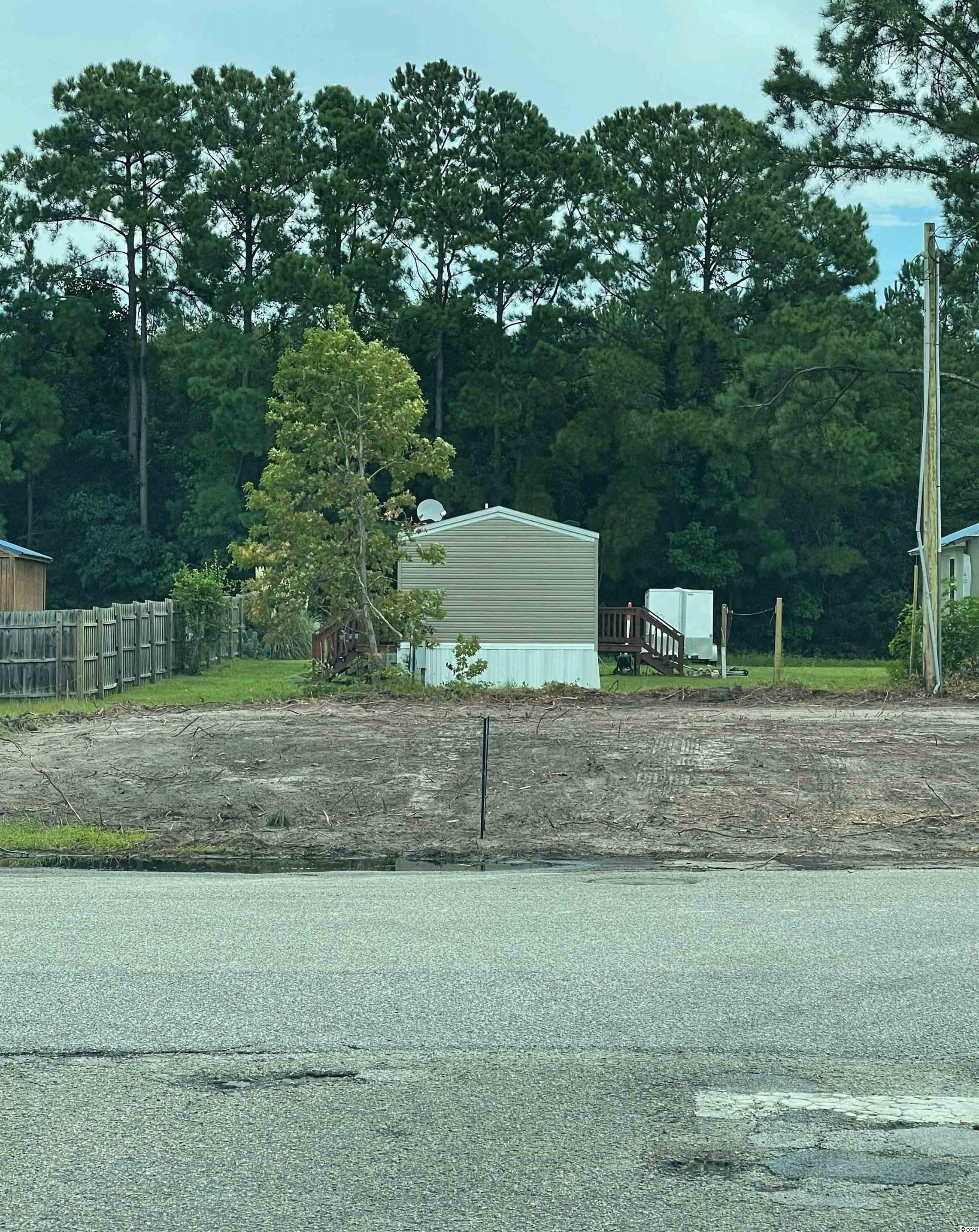 Cleared lot ready for your new home. You can have a mobile home, modular or stick built. Not in a flood zone and NO HOA. And if you act fast this is the last chance at having a double lot in the Grove. The lot beside this one is available also. The grove is 1.2 miles from the beach on a short golf cart ride. Just a few blocks from the ICW and public boat ramp. A short golf cart ride away from restaurants, bars, shopping and more.