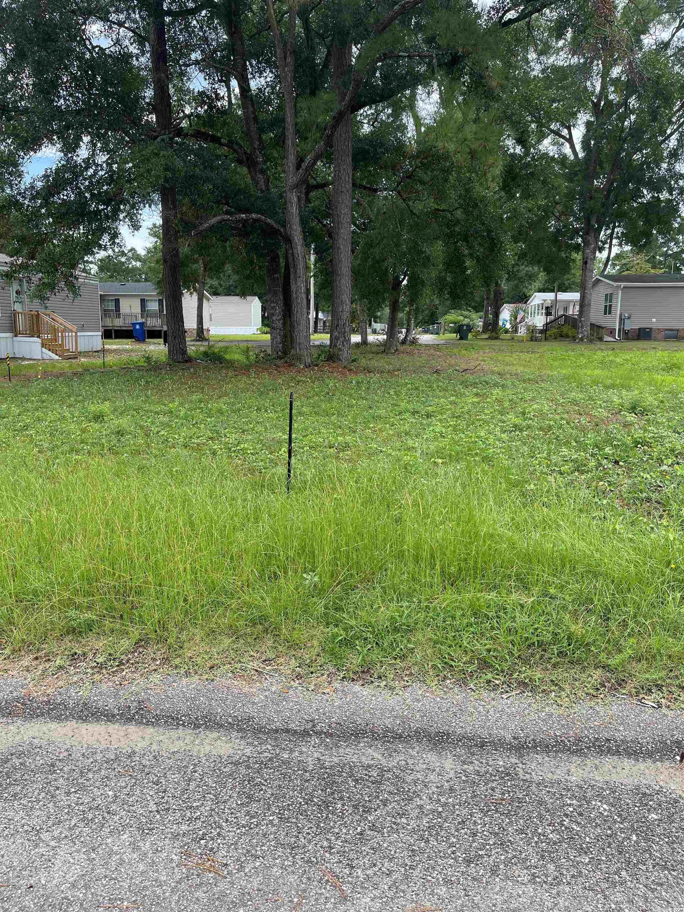 Cleared lot ready for your new home. You can have a mobile home, modular or stick built. Not in a flood zone and NO HOA. The grove is 1.2 miles from the beach on a short golf cart ride. Just a few blocks from the ICW and public boat ramp. A short golf cart ride away from restaurants, bars, shopping and more.