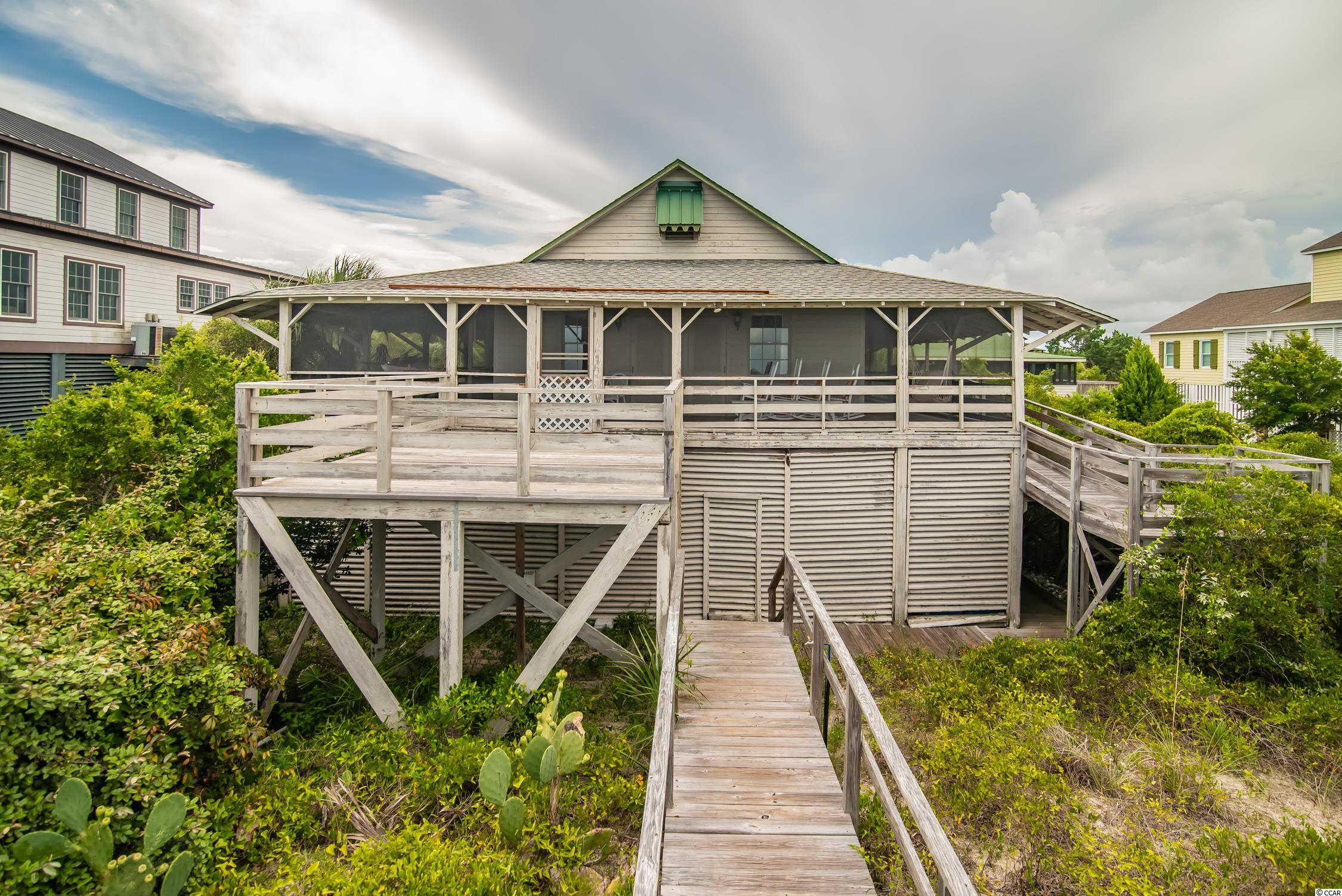 """Welcome to 164 Atlantic Avenue, your """"arrogantly shabby"""" Pawleys Island Beach house.  Situated on one of the largest (wide and deep) lots on Pawleys Island, this house has plenty of privacy and a spacious yard!  Enjoy rocking on the porch or swinging in your hammock while feeling the ocean breeze and watching the ocean waves crash on the shore.  Originally built in the 1930s, this charming Pawleys cottage has a legacy of cherished memories over the generations.  The house has 5 bedrooms and 3.5 bathrooms so there is plenty of room for guests or family!  Home is being sold in """"as-is"""" condition.  Pawleys Island is located just 70 miles for a historic day trip to Charleston, SC or 25 miles to the attractions of Myrtle Beach."""