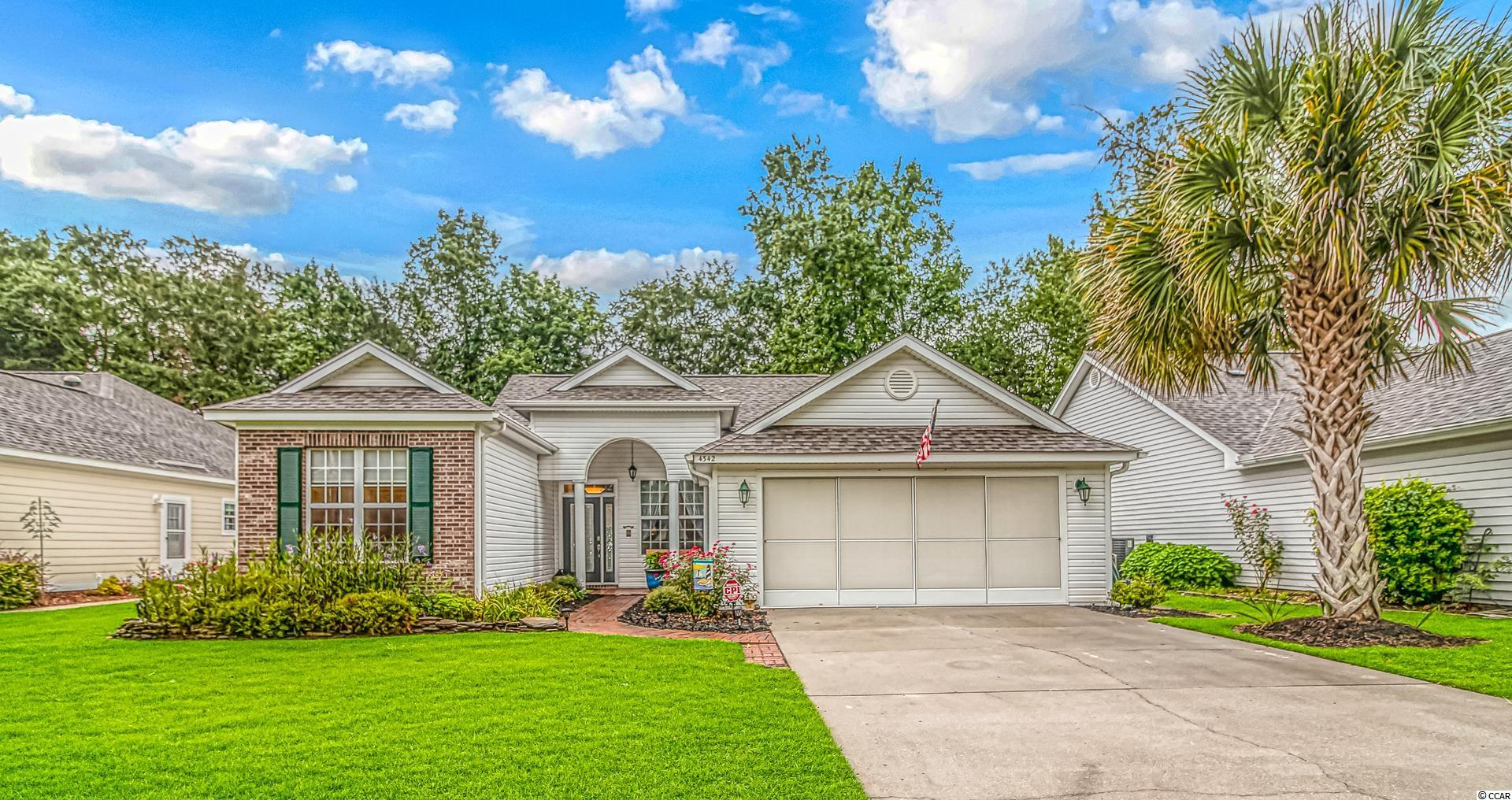 Beautiful views of the golf course and pond from the backyard of this gorgeous 3 bedroom, 2.5 bath home with formal dining room. Located on the 14th fairway, the home boasts a Carrier 3 ton,16 seer HVAC in 2019 and new roof in 2017. From the minute you pull up, you'll notice the lovely curb appeal and landscaping. Step inside the home to find wood flooring extending through the dining room and living room. The dining room is spacious and makes entertaining and gatherings a breeze. The living room has sliders that open onto a large patio--the perfect place for grilling or soaking up the rays. At the back of the house is a large sunroom/den with tall windows overlooking the beautifully landscaped back yard and golf course. The kitchen has been updated with granite countertops, tile backsplash and stainless appliances. Step into the huge master bedroom where you'll find two large closets and an updated bathroom vanity and bench. The front guestroom has it's own on-suite bath for convenience and there is an additional half-bath in the hallway, also with an updated vanity. The third bedroom is currently being used as an office and has great light from the three large windows. A spacious laundry room provides a great place for storage and the garage has enough room for two cars and also features a bump-out extension where you'll find a small workshop. You'll also find a screen pull-down which allows you to close off the garage but leave the garage door open for air-flow. The builder of this home increased the size by 5 ft across the back from what the original plans called for. All this located in the gorgeous Eastport community in Little River. Just minutes  from restaurants, shopping, entertainment, beaches, and all the Grand Strand area has to offer!!