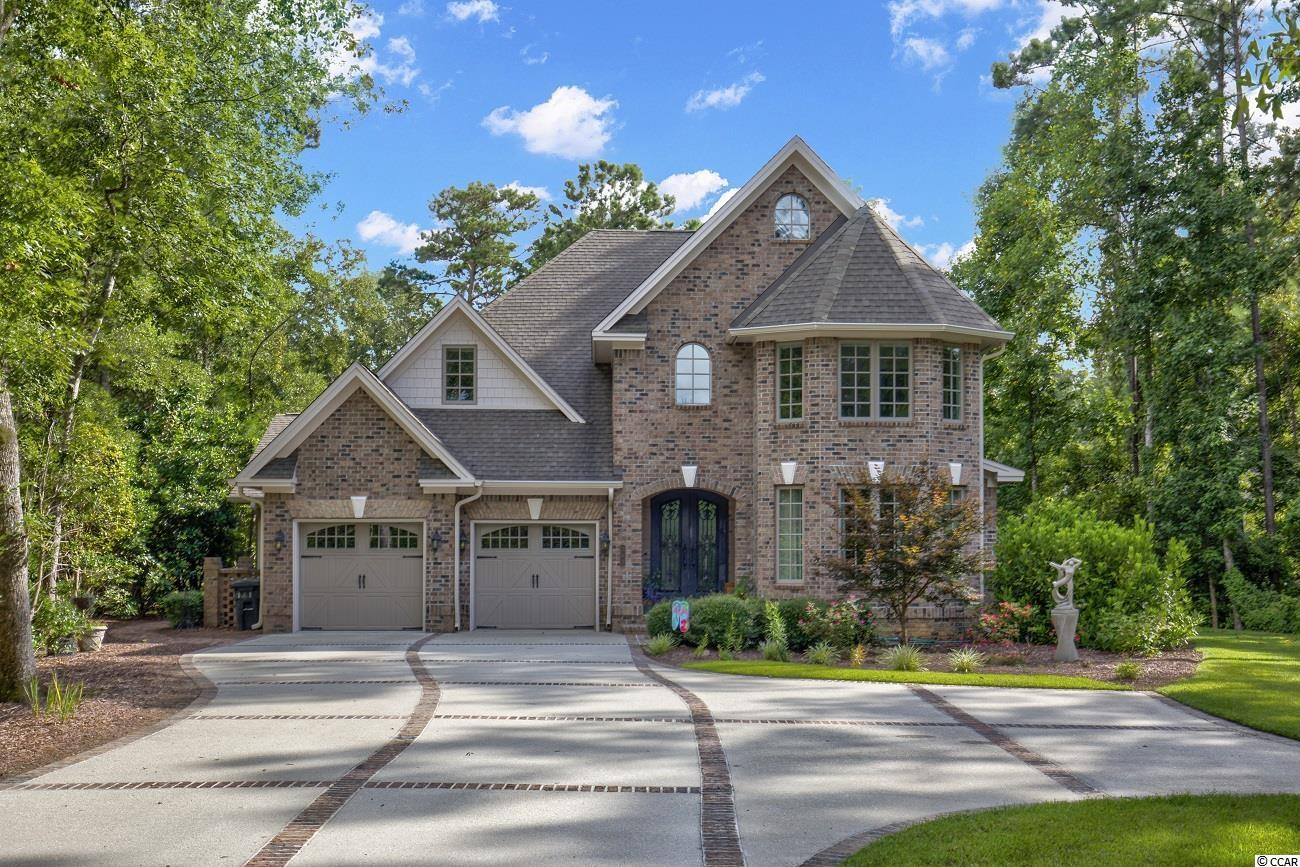"""Custom built all brick home located in the exclusive golf community of Pawleys Plantation. Opened for play in 1988, Pawleys Plantation Golf & Country Club is a Jack Nicklaus Signature Course ranked by Golf Digest among the Golden Bear's finest. """"I have a particular fondness for the Low country area,"""" says Jack. """"We used what's here, without forcing or changing what Mother Nature provided"""". The master suite is located on the first floor with double doors welcoming you to the carolina room that stretches across the entire rear of the home with wonderful private views of your lush backyard and pond through large custom windows. Short walk to the club house driving range and community pool. Perfectly appointed home with modern touches in a traditional/ classic design, in a perfect location, in the perfect neighborhood! This will not last long."""