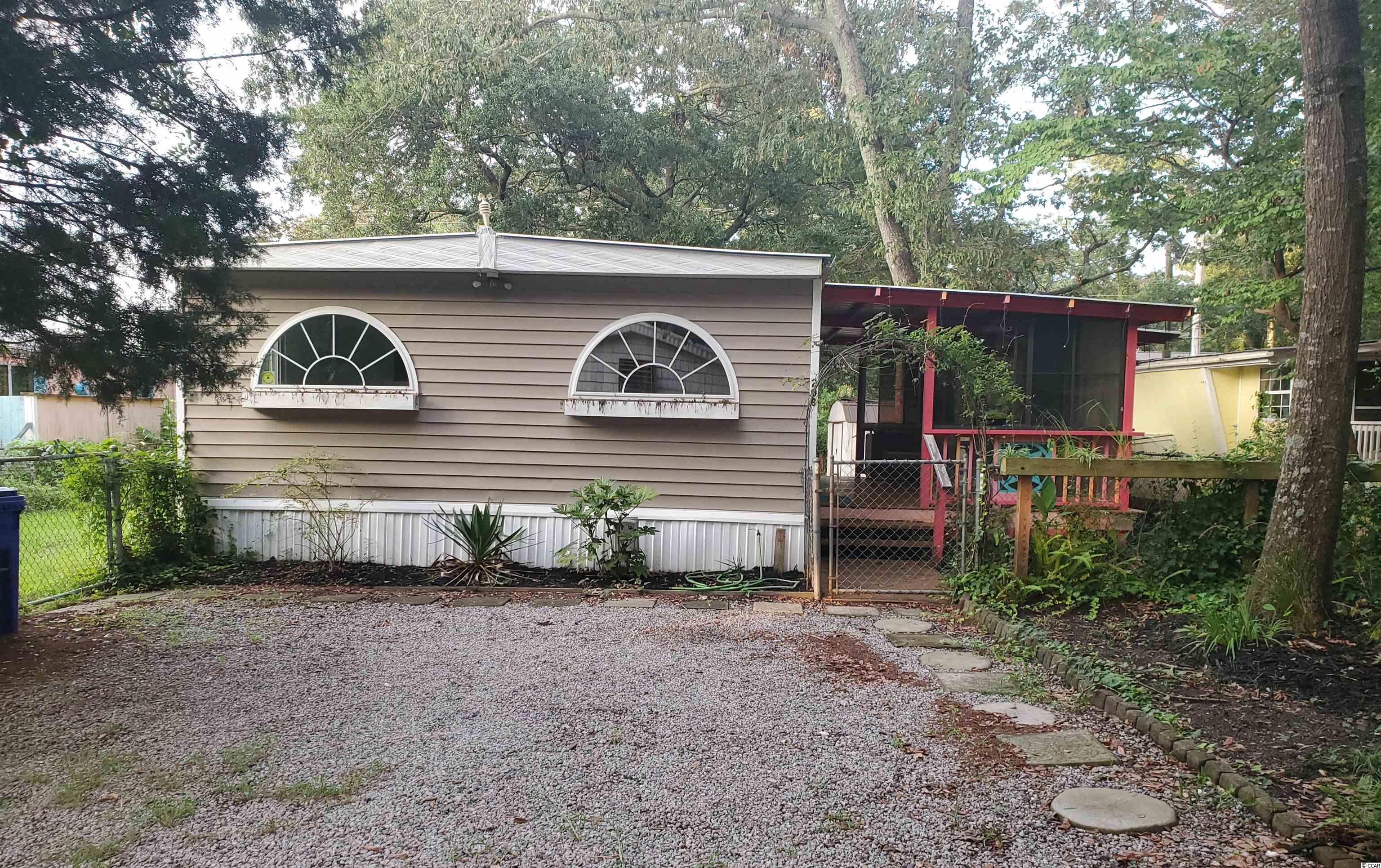 Great opportunity to live near the beach! Located East of 17 Business in Green Dolphin Mobile Home park. Home has 3 bedroom 2 full bath with open concept living/dining area. Covered entry with spacious attached porch is perfect for relaxing outdoors. New Metal roof 2017, new flooring, cabinetry and windows throughout. Home also has a fenced in yard and is golf cart distance to Surfside Beach. On Leased land. Schedule your showing today!