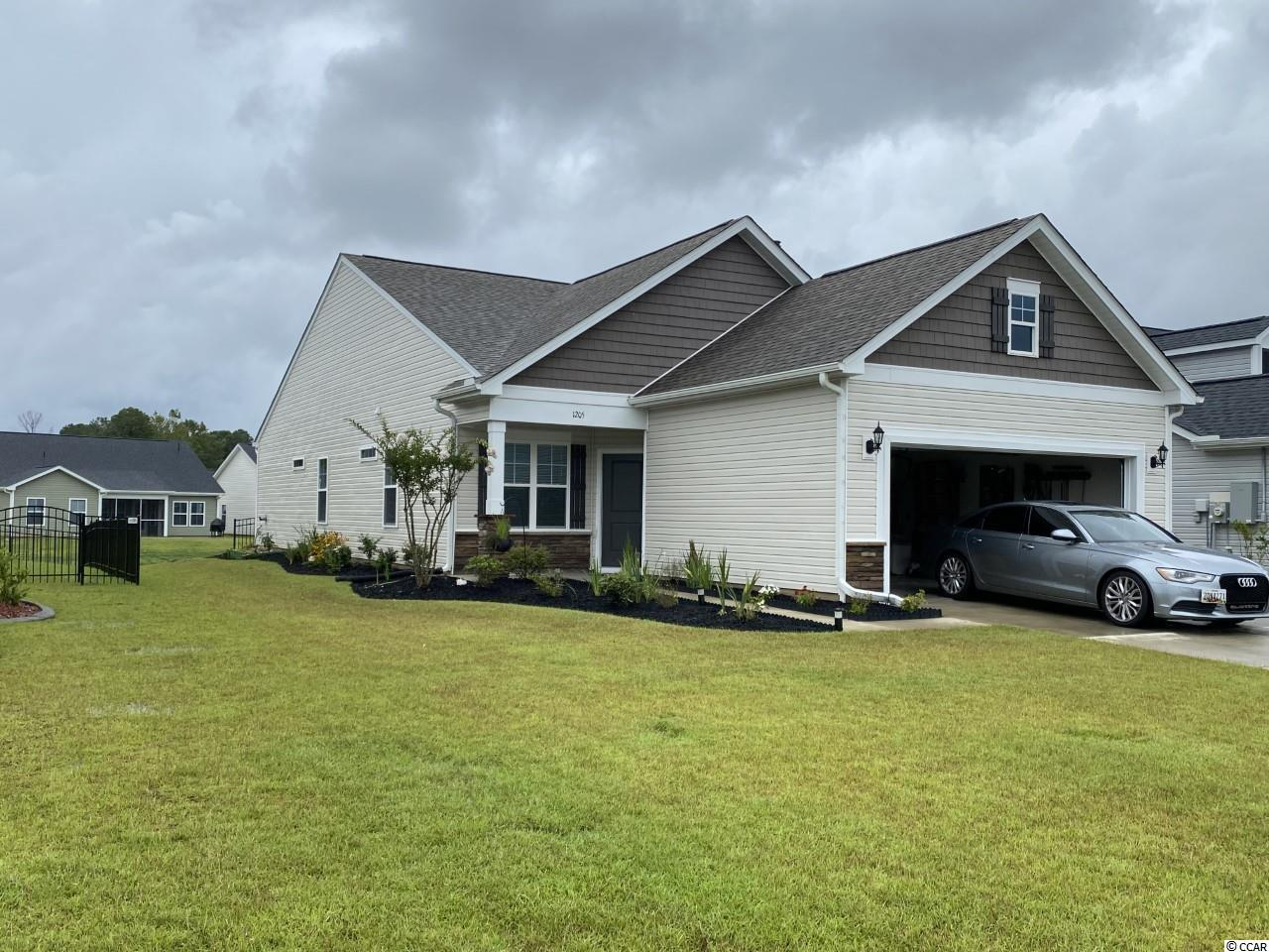 This immaculate home is like new. This home features an open floor plan with cathedral ceiling, luxury Vinyl flooring, 3 bedrooms & 2 baths.  This is a natural gas community . Beautiful granite in the kitchen with a gas range. Enjoy your morning coffee or evening cocktails outback on your screen in porch. Palm Lakes features a gorgeous pool, amenity center and playground. The beach is just minutes away with all it has to offer with dinning, shopping, entertainment and golf!