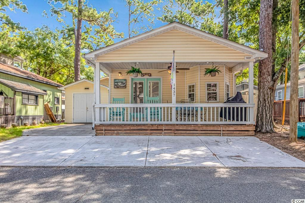 Do you want to live on VACATION full time or have a fabulous rental investment. The SURF SHACK is a 2 bed 1 bath beach bungalow  in the award winning Ocean Lakes, and is just a short stroll or golf cart ride to THE BEACH, the private water park, camp store, snack bar, and all the other amenities that Ocean Lakes has to offer. This beach hide away features a large living room, kitchen with siting area, and a porch for all your entertainment needs. MAKE YOUR DREAM OF LIVING AT THE BEACH COME TRUE!!!!!