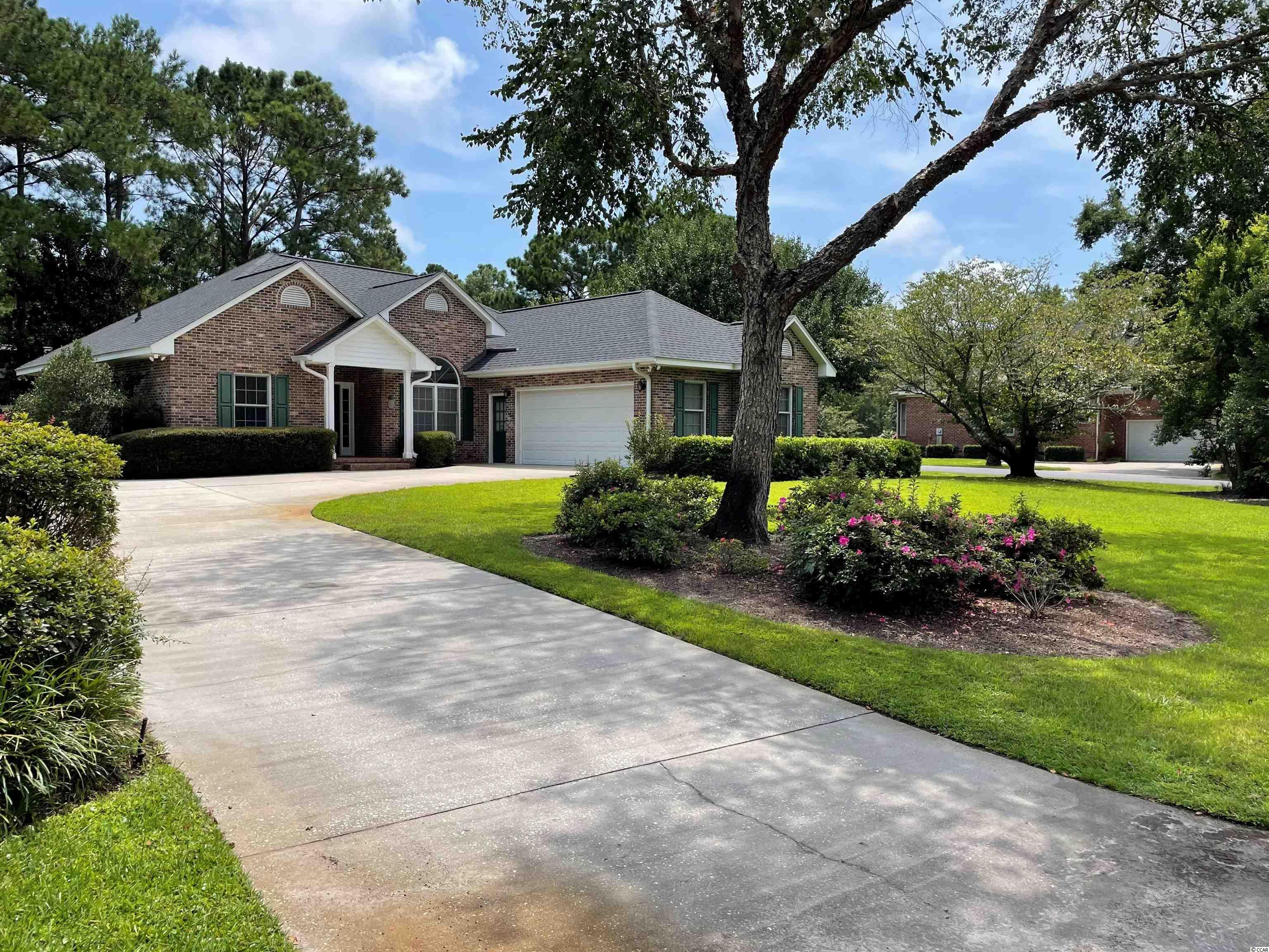 All brick home boasts single-level living within the lovely gated community of River Club. Freshly painted in neutral beach tones, this home is move-in ready. New HVAC and roof in 2020. Floor plan offers 3 bedrooms, 2 full baths, breakfast nook, fireplace in living room and side-loading 2-car garage. Spacious yard with mature landscaping. Long-established golfing community offers a large private pool, club house and golf course. Litchfield by the Sea gives homeowners easy passage to the beach by bicycle, golf cart or car and provides parking, restrooms, outdoor showers and an extensive sundeck surrounding the oceanfront club house. Miles of bike trails pass right by the back gate of River Club, perfect for exploring Murrells Inlet, Huntington Beach State Park, Brookgreen Gardens and Pawleys Island. Easy commute to Myrtle Beach or Charleston. Convenient to medical facilities, schools, restaurants and shops.