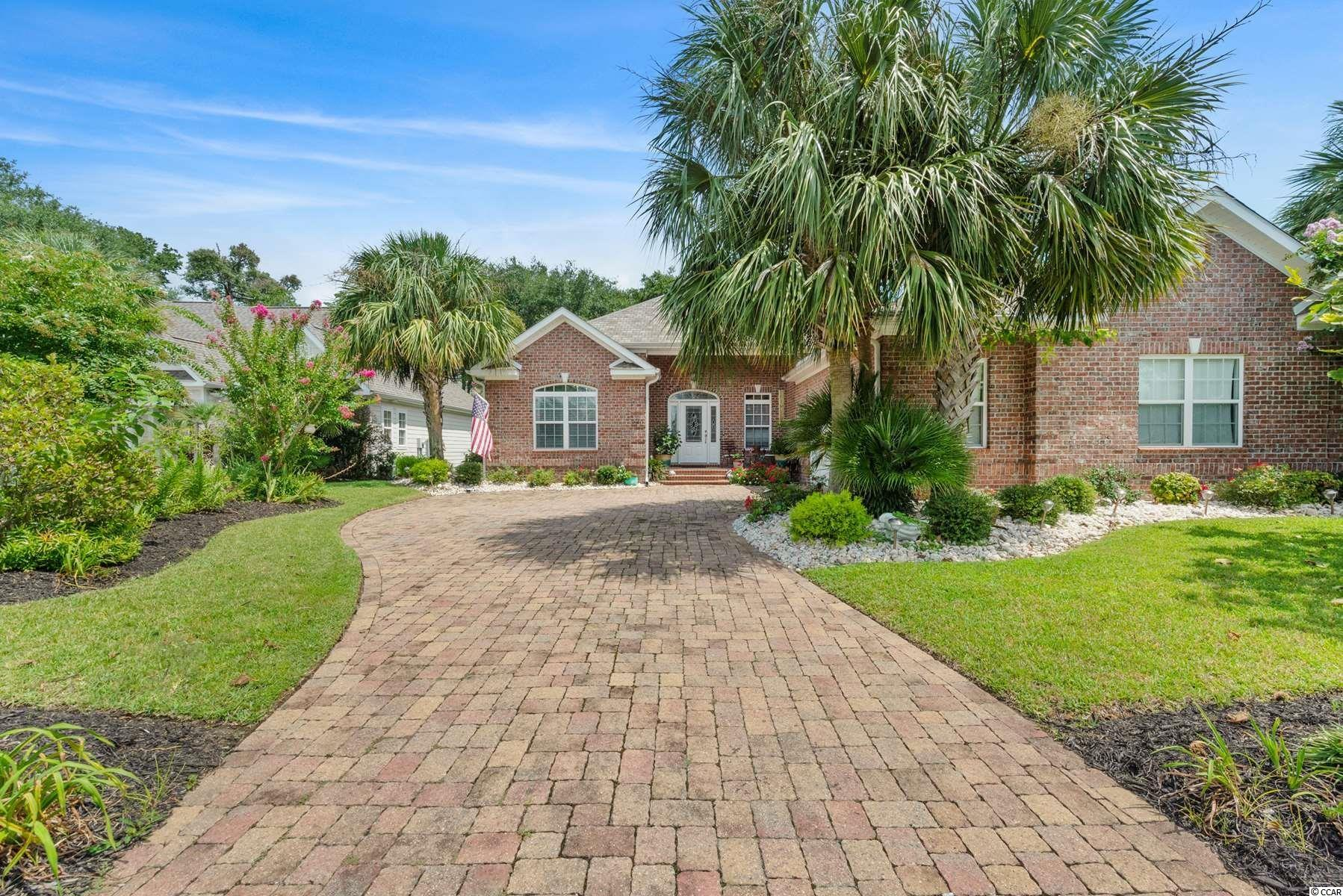 Welcome home to this beautiful 4 bedroom, 3 bathroom home in the highly sought after, gated community, Seaside Plantation in North Myrtle Beach. This home features a European Floor-plan, New roof & HVAC, Gas heat, Beautiful landscaping, and located SO close to the beach. The living room features tall ceilings with recessed lighting, a ceiling fan, luxurious Brazilian cherry hardwood flooring throughout, and a gas fireplace as a main focal point with gorgeous built-in shelving on either side. The kitchen is equipped with top of the line stainless steel appliances, granite  countertops, a large work island, a spacious pantry, with the perfect breakfast nook. Enjoy family dinners in the formal dining room, and spend your afternoons relaxing in the beautifully landscaped backyard. Each bedroom includes plenty of closet space, a ceiling fan, and easy access to a bathroom, while two of the bedrooms share a jack and Jill bathroom. The master offers tray ceilings, access to the screened in porch/Carolina room, room for a seating area, and a private master bath with updated double sink vanities, oversized whirlpool tub, and an upgraded walk in shower. The Carolina room can be accessed from 3 points; the living room, kitchen, and master, making it easily accessible from all areas of the home. This home also features a new HVAC unit in fall of 2020, a beach shower in the garage, a tankless hot water heater, 4 additional gas hook ups, unbelievable storage closets, an irrigation system, and more! Seaside Plantation is the perfect golf cart neighborhood, situated close to all of the Grand Strand's finest dining, shopping, golf, and entertainment attractions, and less than 2 blocks to the beach. You won't want to miss this. Schedule your showing today!