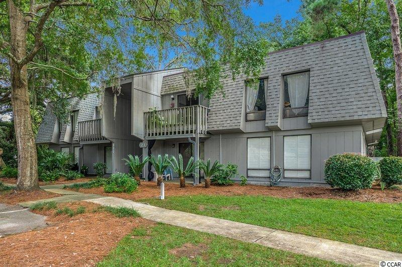 Fully updated and fully furnished in beautiful Pawleys Island!  This property is turn key and move-in ready!  This 2 bedroom, 2 full bathroom, ground floor unit comes complete with hardwood floors throughout the unit so you don't have to worry about carpet anywhere!  The stunning kitchen has granite countertops, stainless steel appliances, and a tile backsplash.  The bathrooms were even updated to include granite countertops and tiled, walk-in showers.  The front patio has a covered roof that directs rain away from you while you sit out and enjoy the SC fall.  Salt Marsh Cove has a great community pool and clubhouse. You even have access to the creeks which is great for fishing and crabbing using the Salt Marsh Cove owners dock. Salt Marsh Cove also has a boat and kayak storage area. This unit is close to the beautiful Litchfield Beaches and all that Pawleys Island has to offer!  Make sure to put this one on your list to see with your Realtor today!