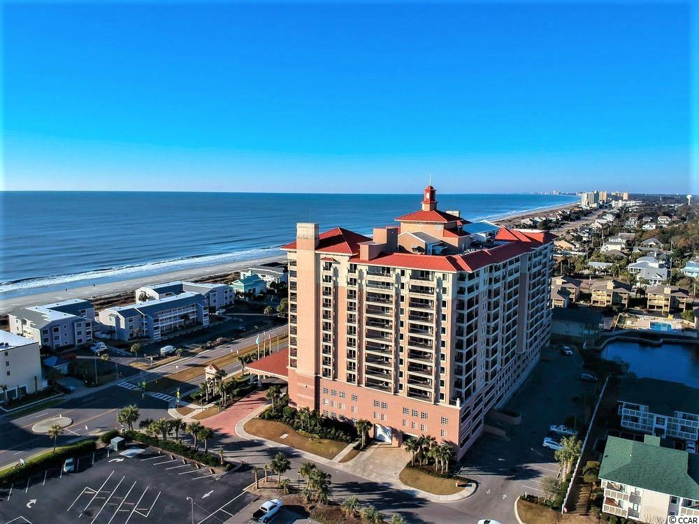 Well maintained, pristine condo with neutral decor and spectacular views of the blue ocean in the Cherry Grove/Ocean Drive area of North Myrtle Beach. Ceramic tile flooring in living area and baths, carpet in bedrooms. This is one of the few condos at Tilghman Beach and Golf Resort that features an extended, extra-large balcony which transforms into a private, outdoor 'living space' with an ocean view. Tilghman Beach and Golf Resorts is renowned for its indoor and outdoor amenities and it is a true year-round luxury resort. Crosswalk and entrance to the beach is located in front of the building and the ocean is just a few steps away.