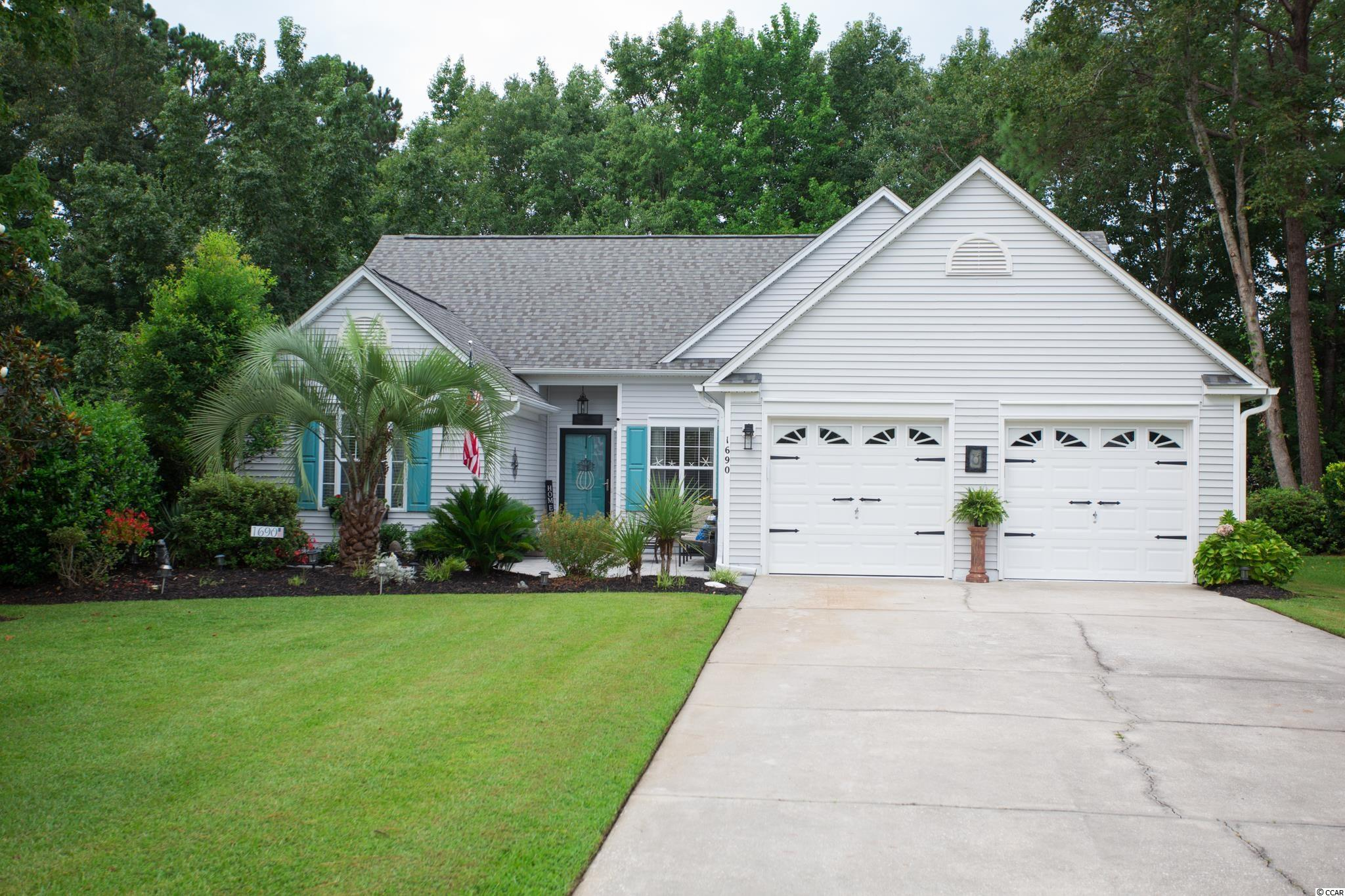 It's A Beauty! Private, serene and Oh What a View! Enjoy the best of Murrells Inlet living in this spacious 3 bedroom, 2 bath home with wonderful views of the pond across the street from the stunning front courtyard in the sought after Indigo Creek Golf Plantation community.   Attention to detail and pride of ownership are immediately apparent in this impeccably maintained home, just a short walk to the Indigo Creek Golf Course clubhouse.  Situated on a lushly landscaped lot on a private street, this home has great curb appeal and sets the tone from the moment you drive up. Start with the welcoming front courtyard with new pavers, shutters, attractive entry door, lush landscaping with manicured lawn, pretty flower beds and mature landscaping.  This is sure to be a favorite spot to enjoy those evening Carolina breezes and the wonderful views of the pond with sitting area.  Freshly painted with open floor plan with the living room open to the kitchen with stunning luxury vinyl plank (LVP) flooring and quality throughout.  Cathedral ceilings in living & family rooms, kitchen and master bedroom, create an open and airy feel while the crown molding and neutral colors of the walls will make you feel right at home.  Entertaining will be easy in this home with its living room, family/Carolina room, spacious kitchen and formal dining room. Living room with vaulted ceiling, attractive fan and windows bringing in lots of natural light.  Gourmet kitchen with new LG stainless steel French door refrigerator, range and microwave, cream cabinets, walk-in pantry, granite countertops, coffee and breakfast bar, pendant lighting and decorative plant shelving.    Formal dining room with crown molding will be the perfect spot for hosting holiday meals and more formal events.  Split bedroom plan with spacious master bedroom with vaulted ceiling, walk-in closet, ceiling fan and windows overlooking the backyard.  Master bath with garden tub, separate walk-in shower, updated vanity with new 