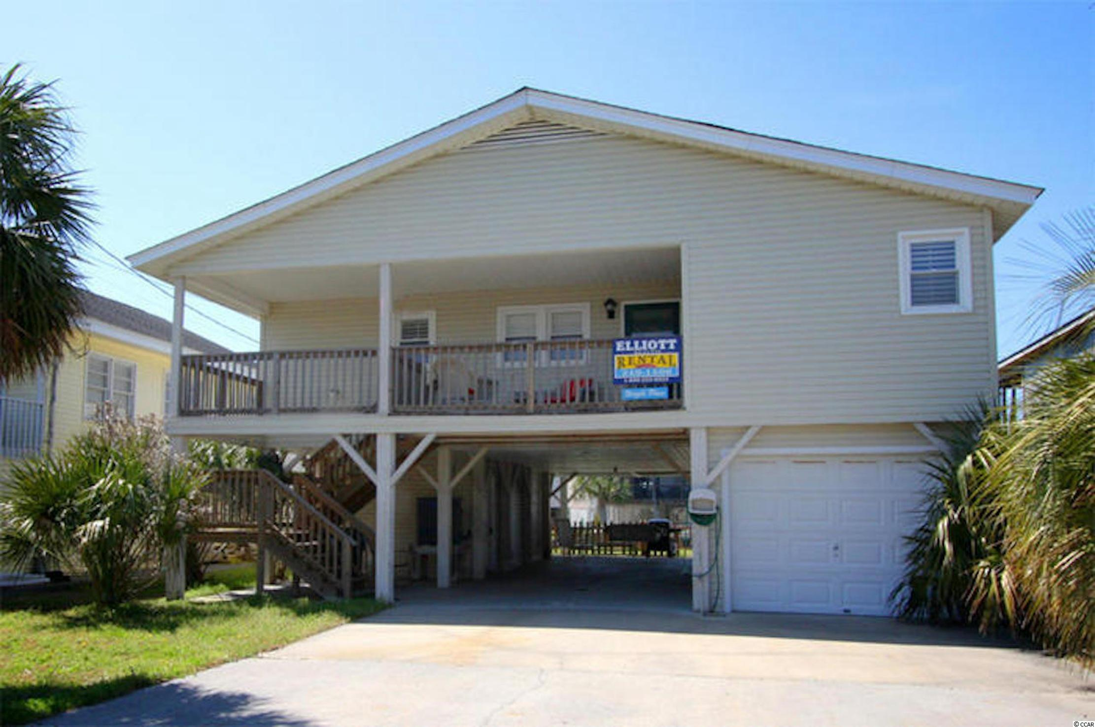 Welcome to this beautiful 4 bed - 2 bath home in the heart of North Myrtle Beach. This home is situated on one of Cherry Grove's highly coveted deep water channels, and just a short walking distance to the sandy beaches of the Atlantic Ocean. Recently remodeled, this home boosts luxury vinyl plank flooring throughout, granite countertops throughout, and an updated lighting package. There was no expense spared during the creation of this outside oasis. The backyard is perfect for entertaining the entire family, which includes a pool, patio, and floating dock. Imagine grilling out for friends and family on the back patio, or watching the sun rise over the channel while sitting on the balcony. This home has it all! This home is currently on a vacation rental program, and has an exceptional rental history!