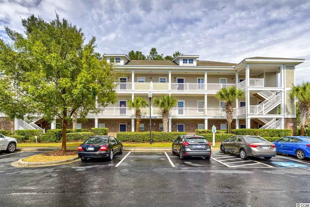 """Excellent opportunity to own a lovely 2br/2 bath condo in Willow Bend at Barefoot Resort. This is a most desirable  """"End"""" unit being sold completely furnished with plenty of natural light and privacy overlooking the wooded area and Norman #8 fairway and green.  """"Freshly Painted & New Hardwood Resilient'' flooring throughout condo. You will love the openness in the living and dining room area along with the lovely furnishing through out the home. Enjoy Resort Living at its best with Four World Class Golf Courses, a private Ocean Front Beach Cabana w/shuttle service, deep water marina, multiple restaurants , great shopping & entertainment across the bridge and much more... This home also comes with a """"TRANSFERABLE GOLF MEMBERSHIP'' saving you thousands. Complete ''New HVAC System & Hot Water Heater"""" replaced 2 years ago. This one won't last long, come take a look!"""