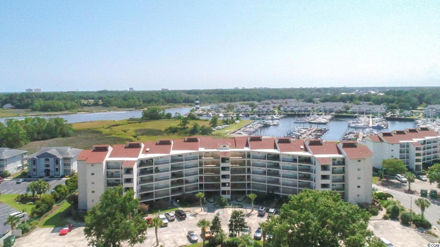 This is Boaters Dream ready for your boat and water toys.  This is a Fifth Floor 2 BR 2 BA unit with a large covered Patio, and a spectacular views of Coquina Harbor, Marsh and Intra-coastal waterway.  This condo has a huge covered patio that enables residents too barbecue on their decks with propane grills, making this an additional unusual find.   This unit just underwent renovations, with imported ships lathe in the main living area, and both renovated bathrooms.  The HOA includes building insurance, water, sewer , phone , internet and wifi.  The HOA also has a club  house available for owners use and private reservation, as well as a beautiful outdoor pool and hot tub that includes a large picnic area under a cabana.  All condos in this boaters oasis come with at least one boat slip membership located in the adjacent Coquina Harbour Yacht Club marina with an associated association fee which includes, dock maintenance, water and electric for each membership slip.    Boaters look no further, your dream awaits you in this spacious condo with huge outdoor living space that brings the outdoors in and makes for great entertainment space.  When you step into this unit the decorators touches are everywhere, and it shows like a model.