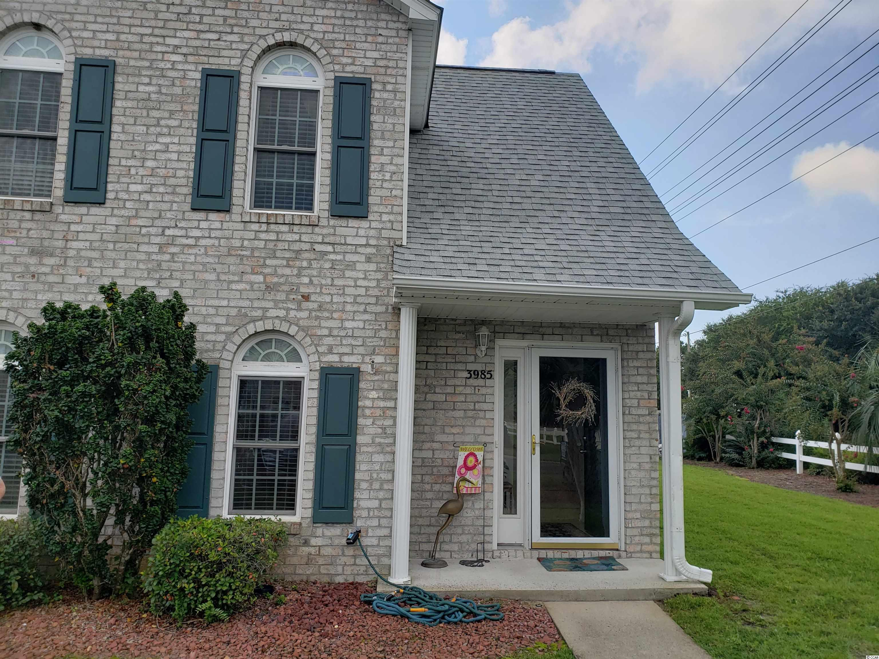 THIS VERY WELL MAINTAINED 3 BEDROOM, 2 BATH TOWNHOUSE IS AN END UNIT.  COMES FURNISHED, MOVE IN READY.  NEWER LAMINATE FLOORING DOWNSTAIRS.  EASY ACCESS TO 17, TO LITTLE RIVER WATERFRONT AND LESS THAN 10 MINUTES TO THE BEACHES OF CHERRY GROVE AND NORTH MYRTLE BEACH.  ROOF INSTALLED IN 2019, HVAC REPLACED IN 2020.  ALL APPLIANCES CONVEY ALONG WITH WASHER/DRYER.  CAROLINA ROOM IS COOLED WITH AIR CONDITIONER.  LOVELY BACK AND SIDE YARD TO ENJOY.  LARGE SQUARE FOOTAGE CONDO WITH TONS OF STORAGE.  CLOSETS, CLOSETS AND MORE CLOSETS.