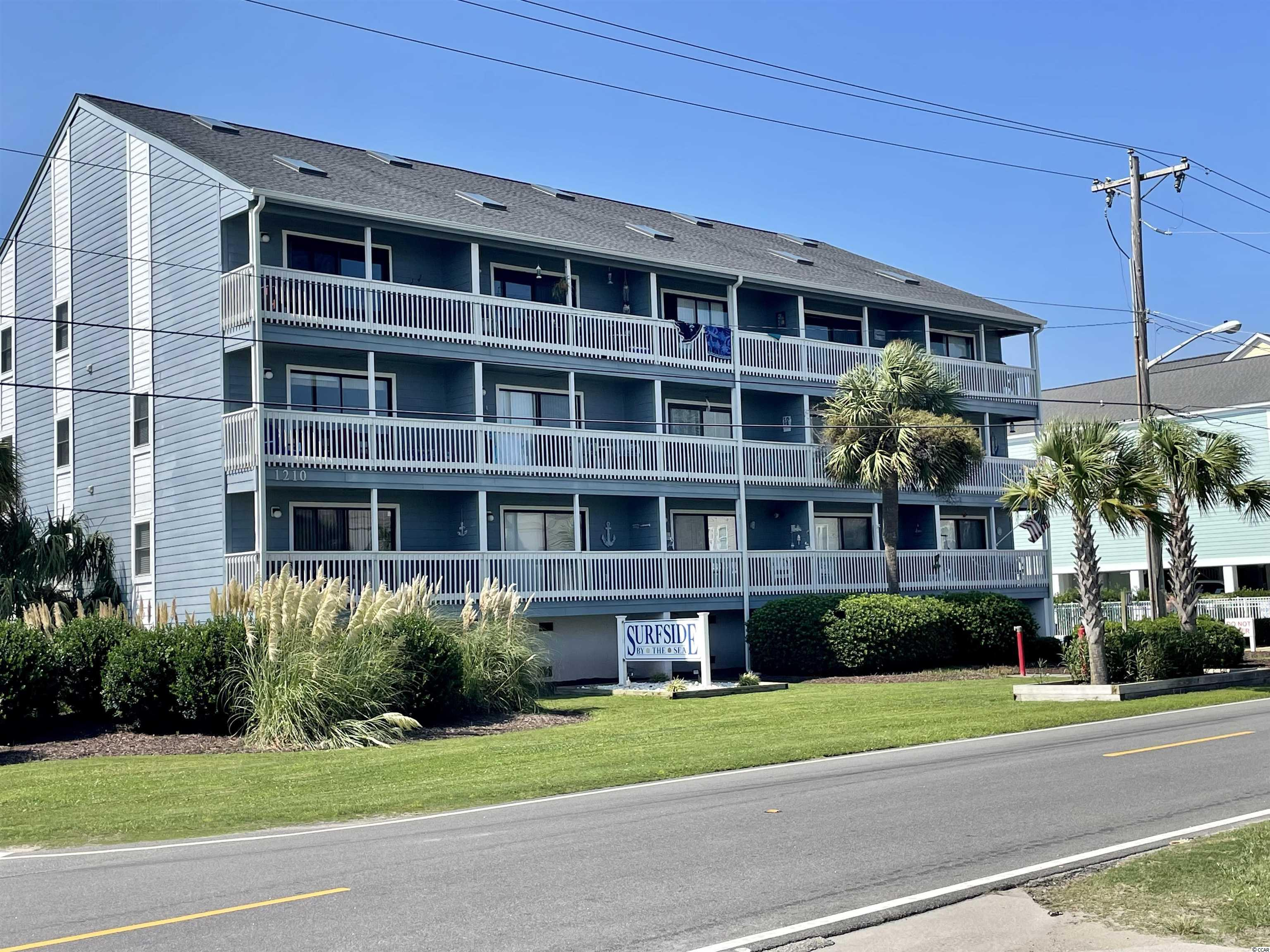 """Come see this beautifully furnished and well maintained 3 bedroom/2 bath, end unit, top floor second row beach condo with enticing ocean views in Surfside Beach! Public beach access directly across the street. You are just steps away from """" Toes in the sand"""".  Villa 305 is located on the southern end of the complex with plenty of natural light throughout. The spacious open living room with vaulted ceilings & skylights, a fully equipped  kitchen with a breakfast bar and dining area that are all accessible to a covered porch facing the ocean with breathtaking views! Two nice size bedrooms ( 2 twins and a queen) and a bath are on the main level along with the laundry area. Just off the living area, a stairway leads to a large 12 x 16 lofted master bedroom( queen) with a sitting area, a 5 x5 walk in closet and bath. Bedrooms are carpeted and all living areas are luxury vinyl plank flooring. Many upgrades and improvements to include: 2012- new HVAC, hot water heater, ceiling fans 2013- smooth ceilings, granite counter tops in kitchen, undermount sink with new plumbing, new stove & microwave, 2015- new skylights and roof, new washer & dryer, luxury vinyl plank flooring and carpet, 2017 pool resurfaced 2020- new refrigerator, dishwasher, garbage disposal, sink fixture, lights and fixtures in both bathrooms, new furniture throughout except the two twin beds. Couch in living room is a sleeper sofa.  2021- new 8 ft hurricane rated sliding glass door. The complex is beautifully landscaped, has a  large community pool, plenty of parking and a small picnic area for cookouts. Owners use this as a 2nd home and has never been rented."""