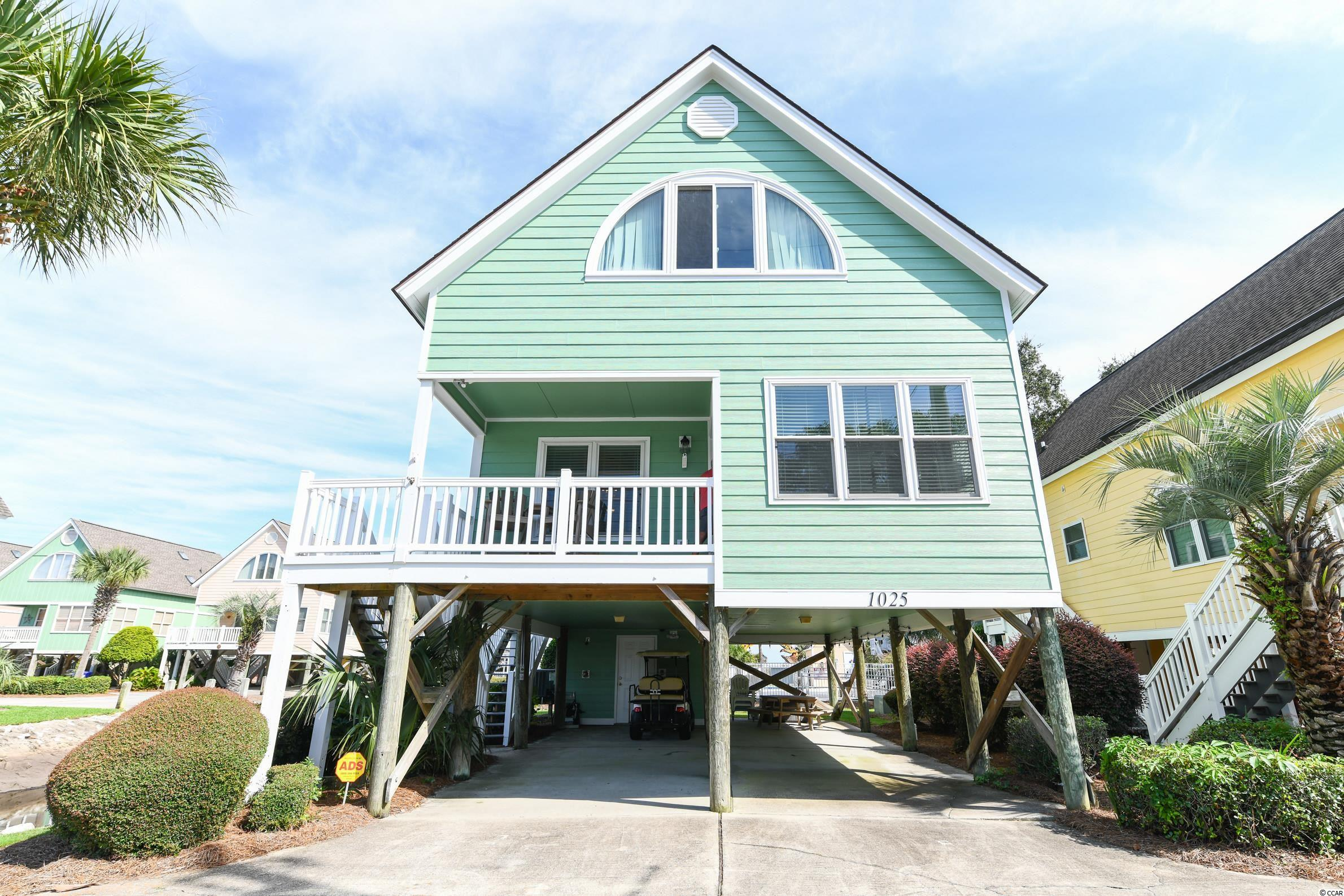 Located a short walking distance from the beach in north surfside is the meticulously maintained and highly desired Sea Bridge community. Enjoy impressive sunsets overlooking Dogwood Lake from the front porch with extra privacy and parking provided by the natural swash flowing to the ocean. Used lightly as a second home since purchased this beautiful 3 bedroom and 2.5 bath raised beach home is ready for you. Perfect as a rental this beach home is sold furnished with many recent improvements including but not limited too; newly painted and installed Hardi plank siding, low maintenance Trex composite decking on all porches/stairs including vinyl railings, remodeled kitchen including new sink,  countertops & stainless steel appliances, new HVAC, new washer & dryer,  and LVP flooring downstairs just to name a few. The private community pool is located just steps behind the property and partial ocean views can be had from the upstairs second bedroom while overlooking the pool. Call me or your realtor to schedule a private showing before its to late.
