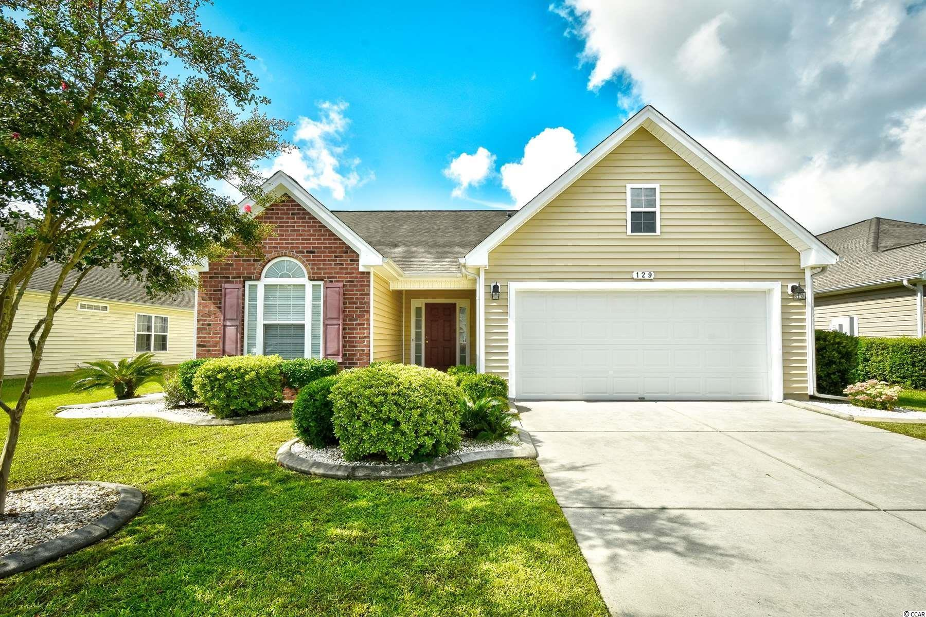 Welcome home to this 3 bedroom, 2 bathroom home in the quiet, golf course community of Arrowhead. This home can be sold fully furnished,features a spacious open floor plan of the main living areas with tall vaulted ceilings and luxurious dark wood flooring throughout. The kitchen is equipped with all appliances, granite countertops, a pantry for extra storage, and the perfect breakfast bar. Just off the kitchen and living areas is a grand archway leading to a Carolina room that can be used as an office, formal dining area, or additional living area. Each bedroom features a ceiling fan, plenty of closet space, and easy access to a bathroom, while the master continues the tall vaulted ceilings and offers room for a seating area, a large walk in closet, and private master bath with double sink vanities, walk in shower, and a whirlpool tub. Spend your afternoons relaxing on the screened in back porch with windows that can turn it into a Carolina room, or spending time with the whole family in the fenced in backyard. Arrowhead offers great amenities including a community pool, tennis courts, clubhouse, and more. Conveniently located close to all of the Grand Strand's finest dining, shopping, golf, and entertainment attractions. This one is truly move in ready; you won't want to miss this. Schedule your showing today!