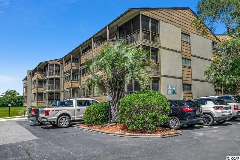 The beach is just a short walk away from this quaint 2 bedroom, 2 bath, meticulously maintained and completely remodeled, end unit condo in Mariner's Cove. It has never been rented, which makes it a rare find. Fully furnished, including appliances, wood floors throughout, new upgraded pendant lights, Alder Birch kitchen cabinets, backsplash, rustic white beach paneling and wood floors throughout gives the interior the perfect beach getaway. The condo offers a perfect spot when it's coffee time or time for a glass of your favorite wine, as there is a tranquil marsh view just outside your screened double balcony. Your master bedroom features your private bathroom with stand up shower with new tiled floors and walls plus your very own private 11x6 balcony, perfect for that cup of coffee.  All the AC wall units and oversized hot water heater is new and installed in 2019. Shore Drive is tucked away from it all and Mariner's Cove is close to a large grocery store, fishing pier, bounty of shops, including Tanger Outlet Mall, Restaurant Row and all that Myrtle Beach has to offer. Mariner's Cove features walking paths, shaded seating decks, and a large swimming pool. Great place to getaway, hidden from main Myrtle Beach tourism and traffic.