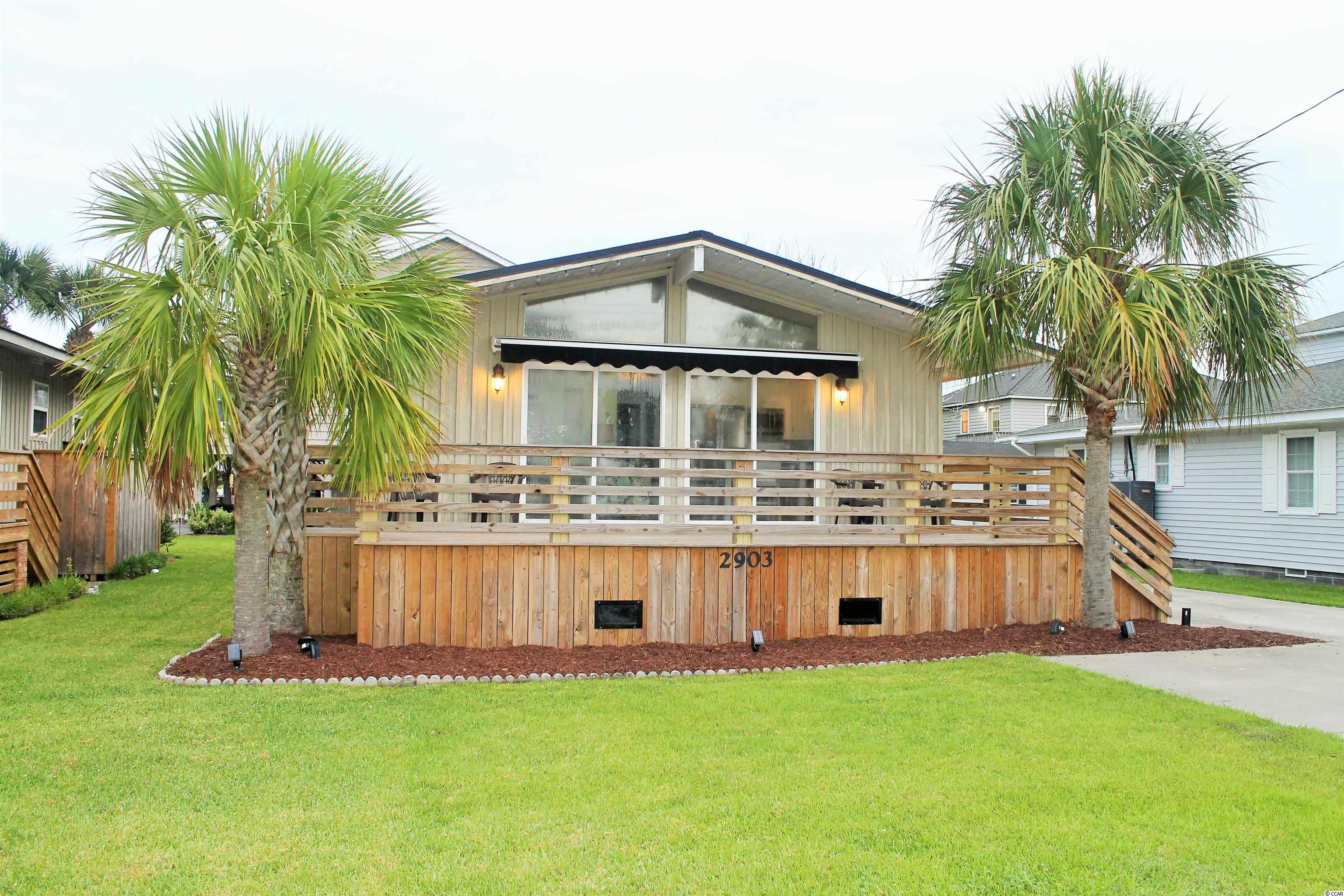 Absolutely beautiful beach cottage two blocks from the beach in desirable Cherry Grove in North Myrtle Beach! Home has been completely remodeled and offers 4 bedrooms and 2 full baths. Kitchen has stainless steel appliances, new cabinets and granite countertops. Brand new carpet in the bedrooms, new flooring in the living room and kitchen. Outdoor shower and detached garage are just the icing on the cake! Oversized awning creates plenty of shade to enjoy your morning coffee on the beautiful deck. This home will make a perfect vacation destination or a great rental property. It's a must see!!!