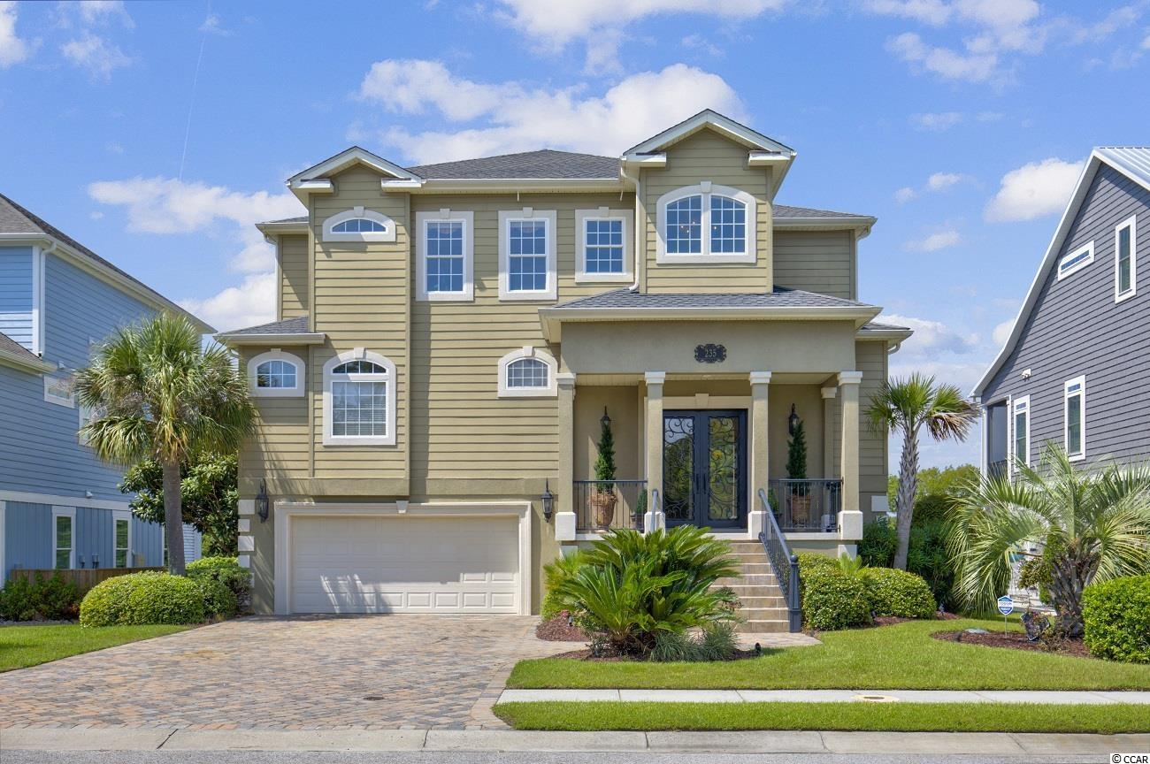 """WHEN ONLY THE BEST WILL DO!  Showing like a model home and quietly tucked away in the Palmetto Harbour waterway community of North Myrtle Beach is where you'll find South Carolina direct waterway living at its finest in this luxurious, beautifully designed home of the highest quality with amazing details from top to bottom and breathtaking waterway views from so many rooms and balconies at all levels.  Stunning front door opens to a custom tiled split entry foyer.  The main living level introduces a grand soaring ceiling in the light and bright living room full of sunshine and  complete with elegant crown and baseboard mouldings,  granite surround gas fireplace, built-in entertainment and book shelving,  top of the line ceiling fan, stunning wood flooring and AMAZING waterway views in a uniquely private part of the waterway as viewed to the other side. Floor plan flows easily into the water front dining area and an incredible open kitchen.  Kitchen is a first class chef's dream with high end GE Monogram stainless appliances, granite counter tops, breakfast bar,  42"""" wood cabinets, soft close drawers, wine cooler, large walk-in pantry, abundant recessed lighting and classic tile flooring.  Conveniently located beyond the kitchen is the elevator (to all levels) and large laundry room with front loading washer/dryer, Rinnai hot water system, shelving and additional space for ironing, more storage if needed, etc.  Lovely main level powder room is conveniently located close to the living room.  Luxurious master bedroom 23' by 13'8""""  is full of light, direct waterway views, and offers access to the beautifully tiled balcony overlooking waterway. Spacious ensuite master bathroom is gorgeous with divided double granite top vanities, stunning vanity mirrors and lighting, jacuzzi tub, walk-in surround tile shower, walk-in closet, and more.  Take the elevator or use the wide wooden staircase to the top level where an office/flex room and two stunning guest bedrooms (12' by 18'"""