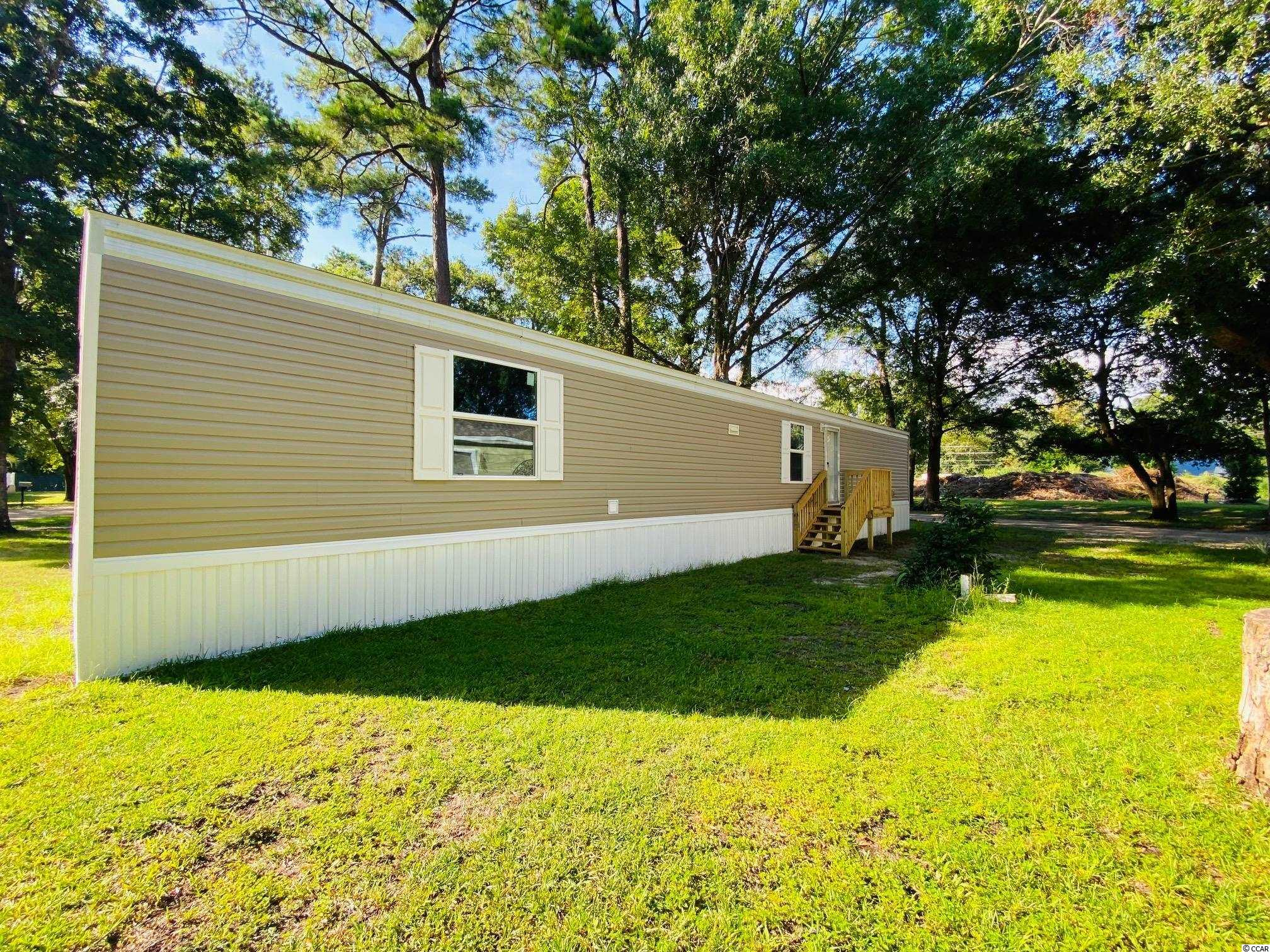 Brand New Manufactured home! 3 Br 2 Ba located in the desirable Waterford Oaks Community. Sits East of Business 17 with just a quick golf cart ride to the beach! Centrally Located to all there is to offer in the surrounding area. This quiet location is close to everything!!!A must see if you are looking for a brand new home close to the beach.