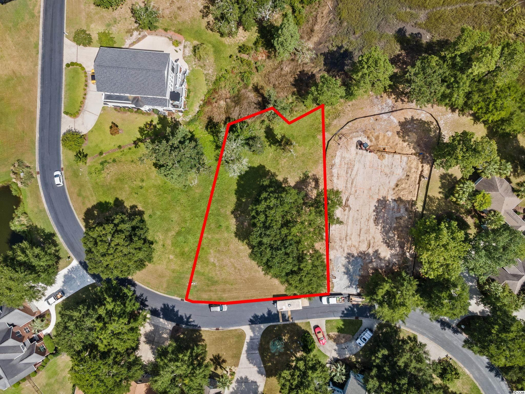 Are you looking for the perfect place to build your home? Check out this Marsh front lot in Big Landing Plantation! Big Landing Plantation is a private gated community that features community pool and its own private beach, pier and dock on the Intracoastal Waterway.