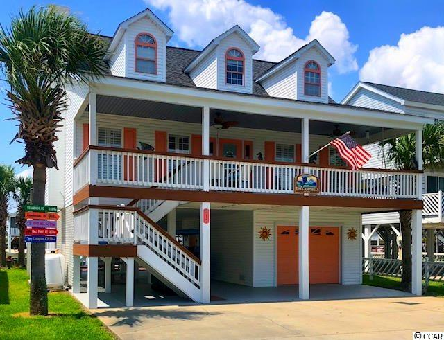 Welcome to Cherry Grove channel living in this completely furnished, spectacular channel home.  Just 1 and 1/2 blocks from the beach.  Perfect for the morning exercise routine or drive your golf cart to see the picturesque sunrises on the Pointe. Imagine sitting on your perfectly cozy front porch taking in the sunshine while you catch-up on some reading. This 6 Bedroom, 4 1/2 Bath home has an open floor plan providing the space for both family and friends! The on point Master Bedroom has a shower that will leave you more than impressed.  Also, has a real Laundry Room attached to the bath. Upstairs is 5 more bedrooms exquisitely decorated. The 5 bedrooms are accompanied by a Jack and Jill bath, an attached bath, and a hallway bath. When you casually make your way back down the stairs and into the Kitchen.  You'll quickly notice the granite counter-tops,  stainless steel refrigerator, stove, microwave, and dishwasher. Then make your way through the windowed Carolina Room overlooking the channel. Or take a relaxing dip in the expansive hot tub on the over-sized back deck. The ground level is laid out to lead you into the awaiting hammocks, newly installed fish cleaning station, or to your floating dock right on the channel.  After that perfect beach day be sure to wash the sand off in your outdoor shower. Store your golf cart, golf clubs, or beach gear in the one-car garage.  Hop on your must have golf cart to enjoy all the restaurants, shopping, kayaking, fishing, live shows, and golf courses along the North Myrtle Beach shore! Don't wait!  You might just be missing out on your new permanent residence or super investment property so book a showing today!!!