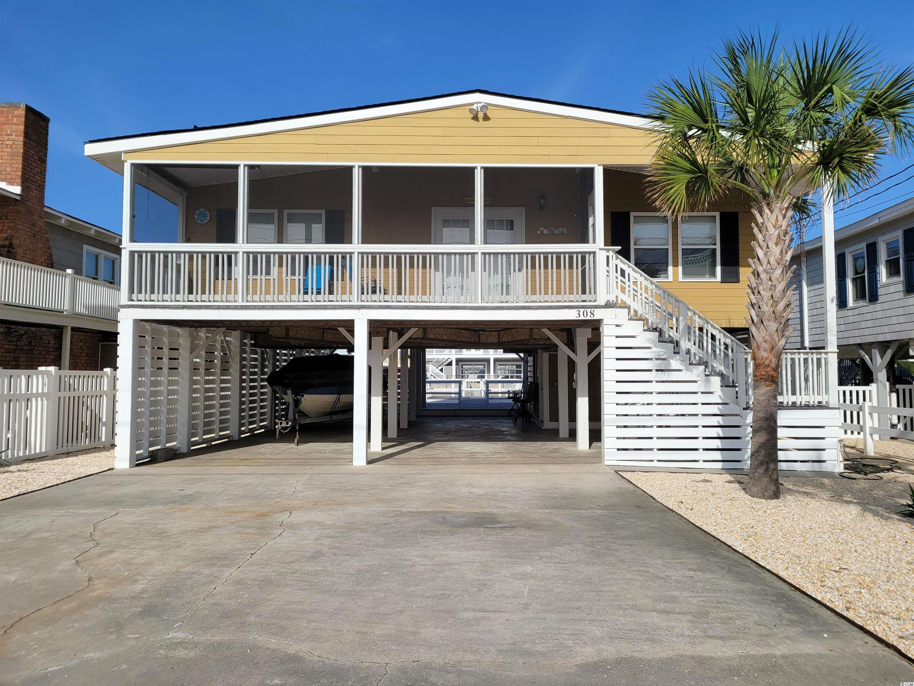 This beautiful 4 bedroom, 2 bath raised beach home on deep channel with spacious deck, patio areas offering lovely views of the channel and marsh beyond.  Delightful screened front porch extends across the front of home and has really great view of marsh.  Entering into roomy family room, inviting dining area and kitchen area with sliding door to Very Large deck overlooking channel!.  HVAC, water heater, roof and most appliances new in 2013.  Never on rental program and only 3 owners!