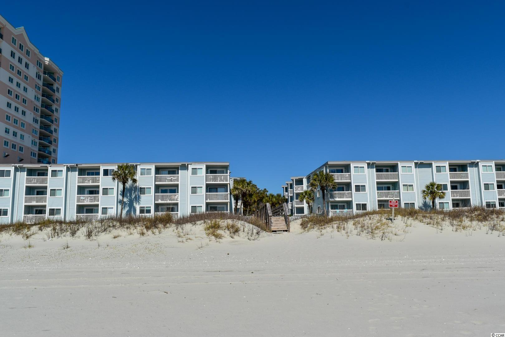 Ocean Garden Villas is in the perfect location! This immaculate unit will have you never wanting to leave the beach! This 2 bedroom 2 bath unit features gorgeous wood floors and beautifully decorated. Enjoy sitting on your balcony and watching the waves roll in. The beach has so much to offer with all the shopping, golf, dinning and entertainment. Great opportunity for your own place at the beach, rental or investment.