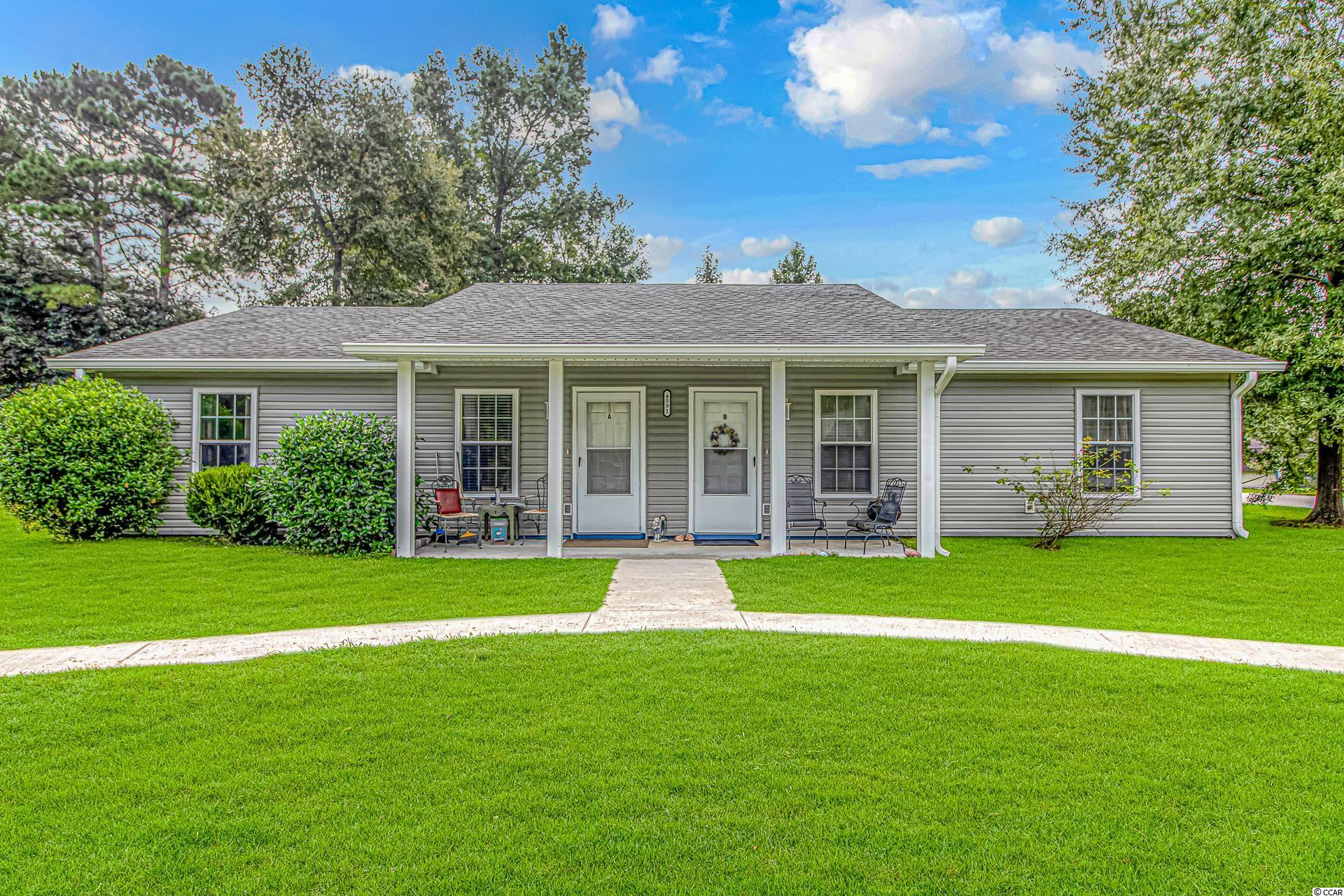 Recently Renovated Rare find Duplex with NO HOA! New Siding, New Roof. Both sides are currently rented. Never Flooded!
