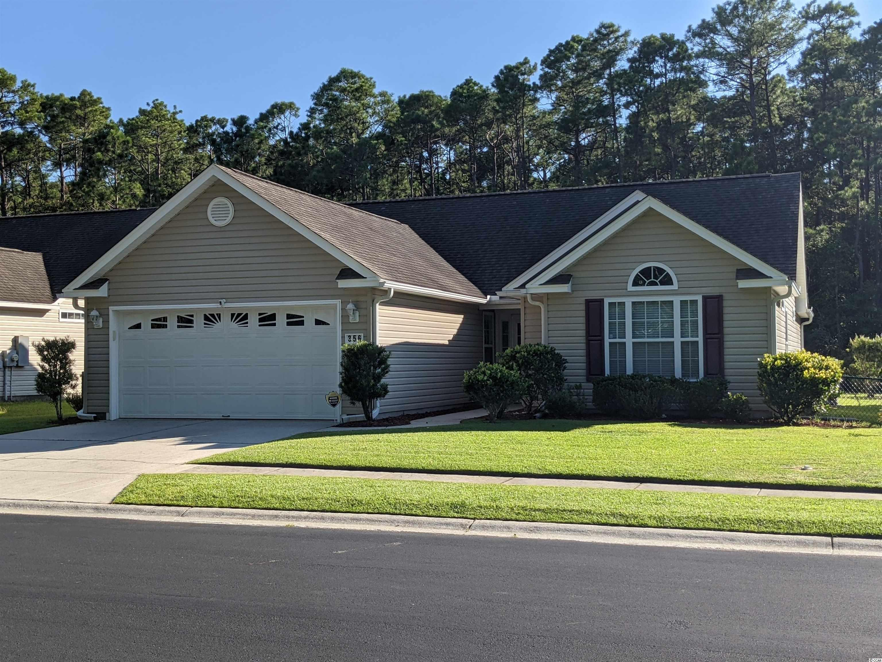 This 3 bedroom, 2 bath home is only a short golf cart ride the beach and a short ride to all Myrtle Beach attractions.  The house is located in a peaceful section of Mallard Landing Village.  This home sits on a spacious lot with plenty of privacy.  The fenced yard backs up to woods and a stream.  The front of the house is located across from a wooded preservation area.  Perfect for bird watching. This freshly painted home has large kitchen, living room, large master bath & 16'x16' master bedroom.  It also features vaulted ceilings, ceiling fans, a large Carolina room and a 3 season Carolina room.  The family style kitchen has plenty of cabinet storage.  The HVAC system was updated in 2017 to an energy efficient system.  The home has a top of the line lawn sprinkler system and wireless alarm system.