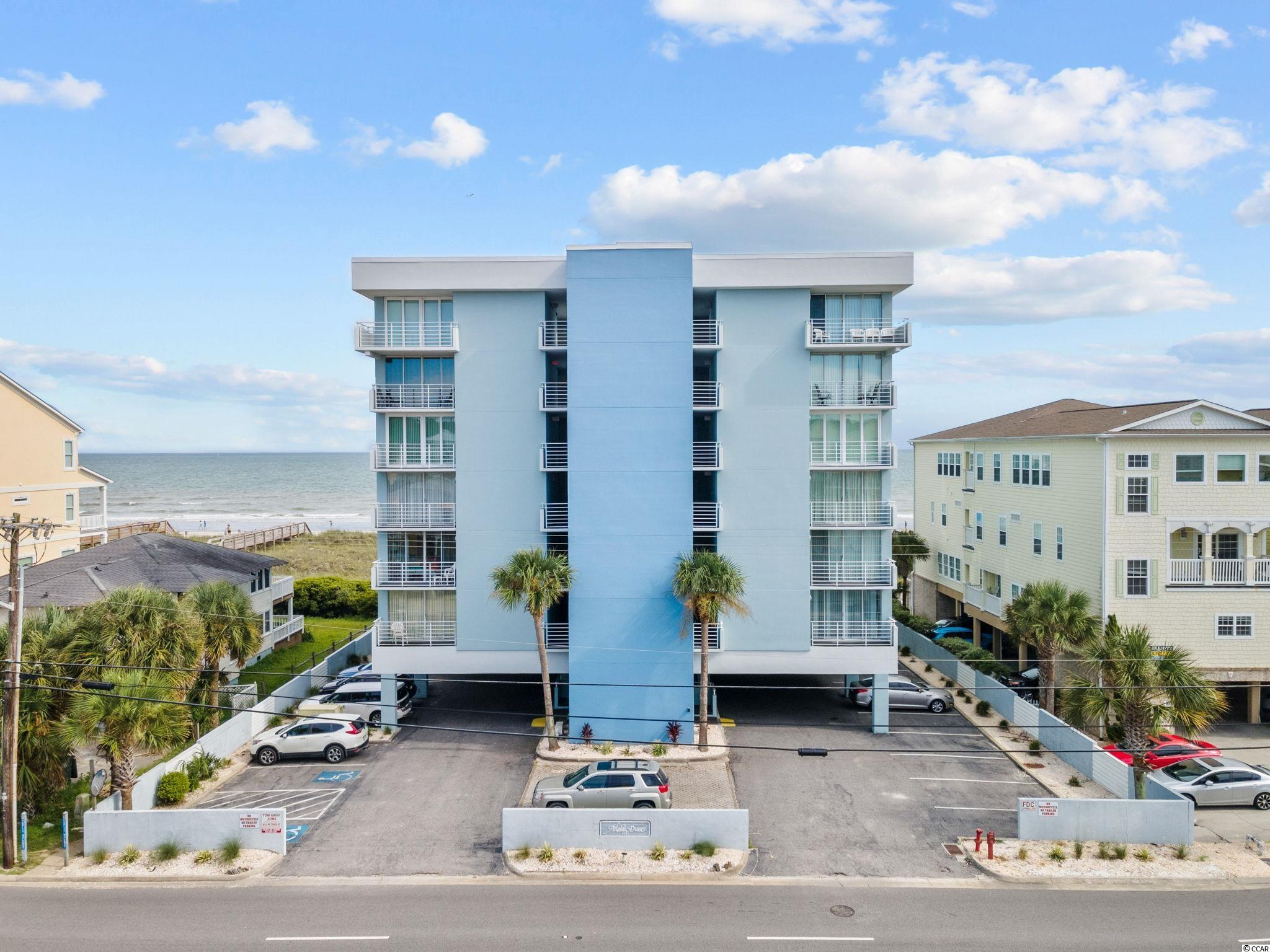 Rare chance to own a beautiful unit in this quiet, boutique building located in the heart of North Myrtle Beach! Atlantic Dunes has just 22 units, has recently had the exterior repainted and the units have all new hurricane impact sliders and windows. This particular unit has had only 2 owners and has never been rented! Sit on your balcony, relax while taking in the beautiful view of the Atlantic Ocean and pool area. Grab a friend and take a walk to the beach over the beautiful dunes on the newly installed boardwalk. This unit is being sold fully furnished and is truly turn key. Schedule your appointment today...you will be HAPPY you did!