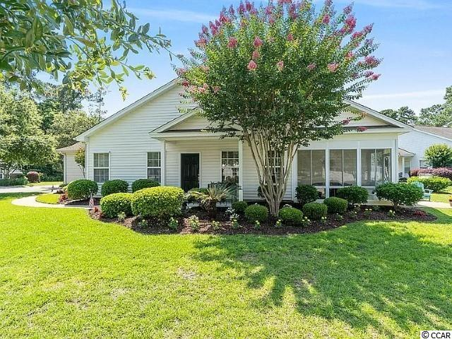 If you've been looking for a single level town home right in the heart of Pawley's Island, look no further. This property has been meticulously maintained and it shows! Home features a large living area with vaulted ceilings and plenty of living space. Living room opens up into the Kitchen and tiled Dining Area. Master Bedroom is large and includes  a spacious Master Bath with dual sink, tile floors, separate tub and shower, and walk in closet. Both guest bedrooms are also large and have a nice shared bathroom. The home also features a nice enclosed porch perfect for all four seasons! Off of the porch, there is a patio as well perfect for grilling! This property does have it's own garage and there is a large community pool perfect for those hot summer days. This community is located just minutes from one of the best beaches in the area. The location is unbeatable. This property won't last long so schedule a showing today!!