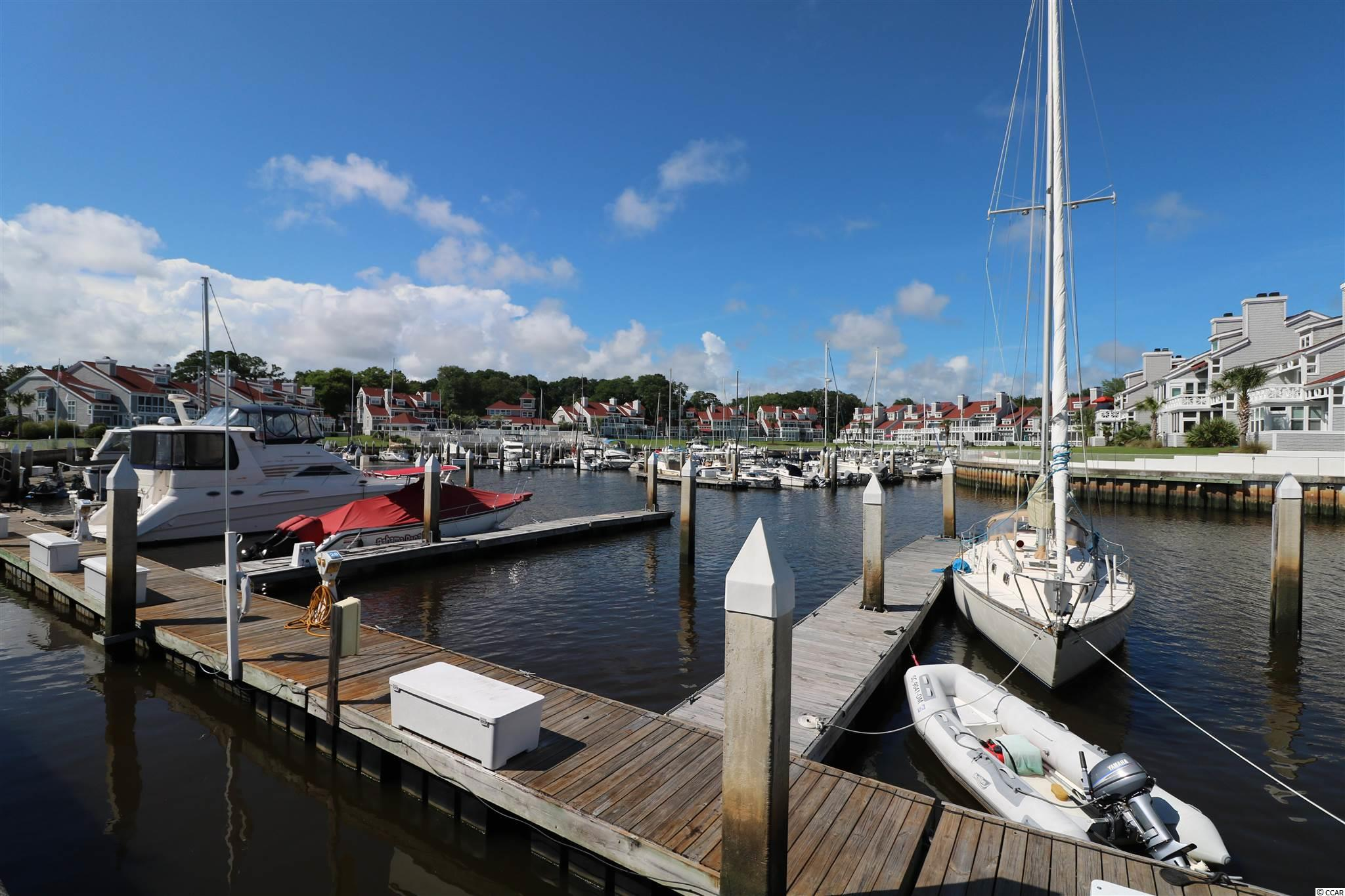 Rare Opportunity for a deeded 55' boat slip. Mariners Pointe is a gated community Intracoastal Waterway community with additional gated access to the boat slips and surveillance cameras for additional security. Slips include water, electric, and access to the community amenities. As an owner you would have access to the pool, hot tub, showers, clubhouse, bar, tennis and basketball courts. Enjoy the  shopping and restaurants of Little River along with the Famous annual Blue Crab Festival and still be just a short drive to North Myrtle Beach.