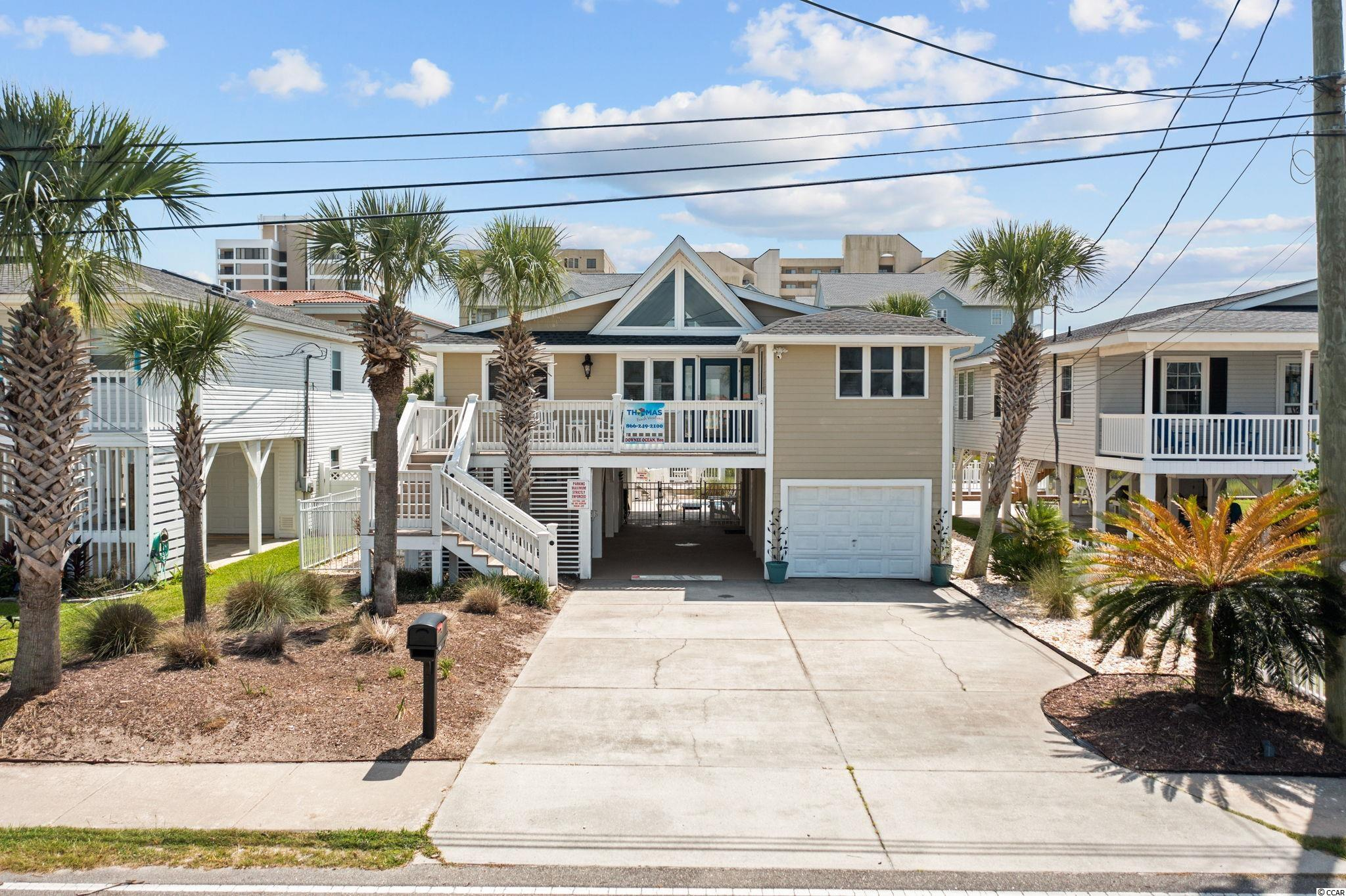 Channel front living at it's best!  This cozy, classic raised beach house has all of the traditional coastal character but has been fully renovated inside and out.  Prime Cherry Grove location, almost at the Pointe on the quiet end of the beach.  Upon entering the home, a large vaulted ceiling greets you and immediately gives you a comfortable and spacious feel with beam accents.  The interior is bright and white, accented with blonde hardwood flooring in the main living areas.   A combination of full view patio doors and windows line the front and back of the home to allow in maximum light and provides continual water views.  The kitchen of the home has been updated with a classic modern feel.  Black granite countertops are paired with crisp white semi custom cabinetry and stainless appliances.  A convenient island provides additional workspace or a spot to gather and eat.  A pale turquoise blue glass tile backsplash adds just a touch of color.  There is plenty of storage space in the kitchen with a pantry, owners closet and utility area.  The floorplan is a mirror image with two bedrooms and hall bath on each side of the home.  Both bathrooms have been substantially upgraded with new vanities, fully tiled surrounds, granite counter tops, glass enclosures, plumbing fixtures and wall colors.  The bedrooms have a textured Berber style carpet and offer plenty of closet space.  Both bedrooms at the rear of the home allow patio door access to the expansive deck.  It's the perfect spot to spend your time listening to the ocean waves and feel the breeze.  Throughout the home added touches and upgrades are apparent.  The trim work has been changed to a craftsman style, new door hardware added and light switches were updated.  The home comes fully furnished including all appliances and electronics.  A new roof and gutter system was added in 2021, the HVAC was replaced in 2017.  The home also is equipped with a Ring camera in the front and rear and wifi keypad door locks mak