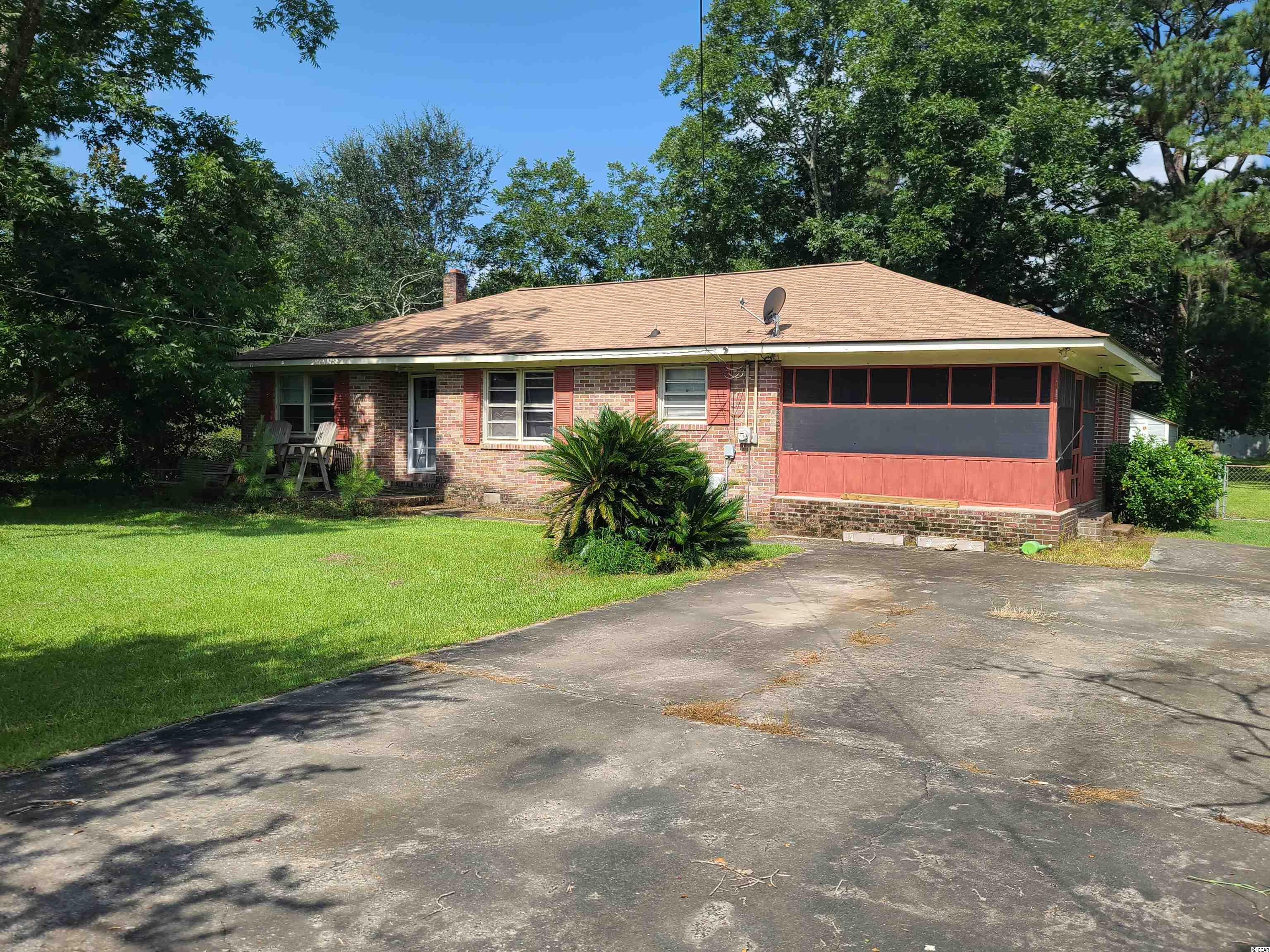 Home is being Sold As Is. This is a GREAT value on this 3bedroom 2 bath home on a huge double lot (fenced in back yard) with lots of mature trees. Home has a screened in porch, large driveway and a detached storage shed. This wont last long! Needs a little TLC.