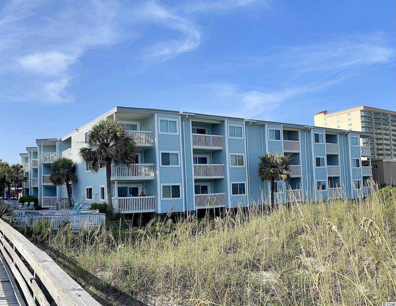 Look no further than this beautiful OCEANFRONT end unit condo located at Ocean Garden Villas in North Myrtle Beach. Situated perfectly on the second floor, this fully furnished turnkey 2 bedroom/2 bathroom condo has breathtaking panoramic views of the ocean and overlooks the pool! Ample sleeping accommodations for all of your guests with a king bed and a twin bed located in the master, as well as two double beds in the second bedroom. Don't miss out on this opportunity to own your perfect vacation getaway!  The owners purchased a new couch, dining room table, and recliner in 2021. New luxury vinyl plank flooring was installed throughout in Sept 2019. HVAC was replaced in April 2016. GE Washer/Dryer replaced in June 2016.
