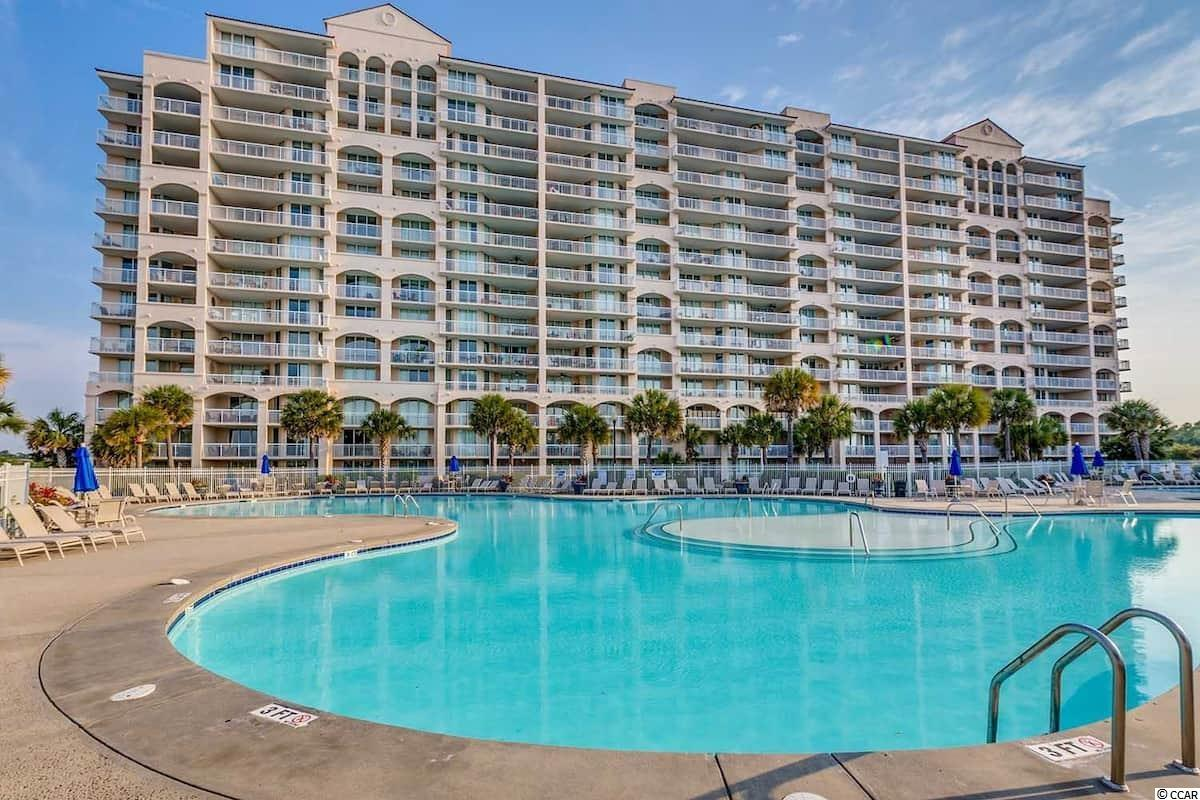 The North Tower of Barefoot Resort in North Myrtle Beach is one of the most luxurious high rise condos on the Grand Strand. It's located directly on the Waterway overlooking Barefoot Marina with a massive pool & hot tub. The condo is exquisitely appointed. The floor plan is very spacious and includes a full kitchen, washer/dryer, expansive private balconies, and more.  This condo is one of the largest 1 Bedroom condos on the Grand Strand and it is home to one of the largest salt water pools in the state.  This is currently an excellent Airbnb rental opportunity!  Our location inside Barefoot Resort offers a lifestyle to envy. You have access to parks, jogging and cycling trails, and jet ski rentals at the Marina. You can spend the day exploring the Intracoastal Waterway or taking a ride with the dolphins.  During season you can take the Barefoot Shuttle to the beach and not have to worry with parking. For air travelers you don't even need to rent a car! Everything you need is right here waiting for you!