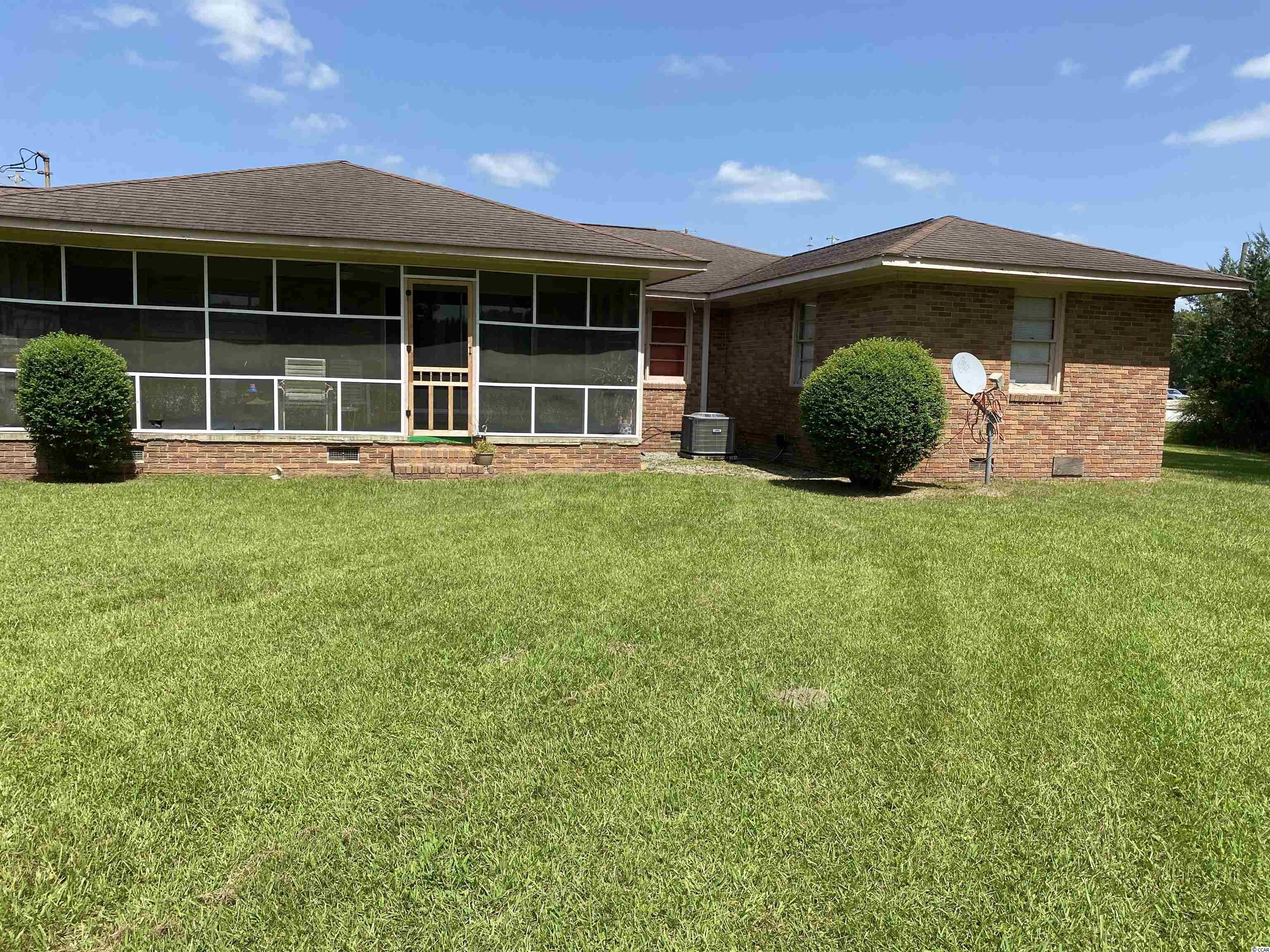 Country living in a convenient location.  All brick home with low maintenance.  New flooring throughout.  Great rental potential for an investment property.