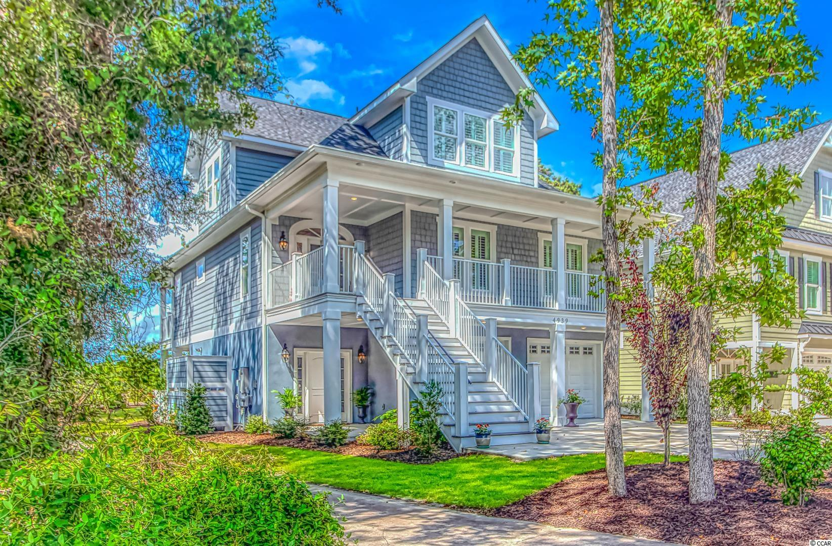 """The FINEST of taste describes this Raised Beach home nestled in the tranquility of Tidewater Plantation. Custom built in 2019, this newer home is offered FULLY FURNISHED. Three floors of showcase furnishings all purchased new when the home was built. Open floor plan allows not only an abundance of natural light but the breathtaking views of the Intercoastal Waterway. Whole house stand out features include Plantation shutters, Rinnai TANKLESS water heater, WHOLE HOUSE GENERATOR, surround sound speakers thru out. Recessed lighting and PLANK TILE  beautifully accents the designer style decor. Lower floor entry invites you in with a mud area that includes built in cubbies with plenty of storage. Extra square footage was added in construction to the lower level to allow for versatility in function.  Two additional storage closets, laundry sink, built in ice maker and 2nd refrigerator will complement any use of this space. Slider door on lower floor opens to outdoor entertaining.....gas grill with attached refrigerator, plenty of space for seating , 3 ceiling fans, etc. perched on the 8th TEE BOX of Tidewater Golf Course.  Main living area opens with foyer and half bath...built-ins in LR surround the TRAVERTINE FIREPLACE with 70"""" flat screen and a Linear remote gas fireplace with color changing ambience. Beautiful QUARTZ countertops in kitchen, MARBLE BACKSPLASH w/accent inset over 5 BURNER GAS COOKTOP. Wall oven/microwave, soft close cabinets and """"cabinet drawers"""", all high end STAINLESS STEEL APPLIANCES w/ CAFE FRENCH DOOR REFRIGERATOR w/ ice maker. Large, walk in pantry. Stunning table and chairs in the Breakfast/DR area that seats 8 people. Bar stools allow for additional and more casual dining. Laundry room- top of the line washer/dryer with cabinets and built in clothes rack- linen closet also located in laundry. Two large bedrooms finish off the main living area- one having an en suite bath. All Bathrooms have QUARTZ COUNTERTOPS. Main living area has its own deck e"""