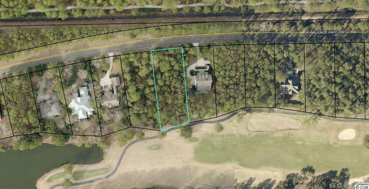 GOLF COURSE COMMUNITY- Beautiful golf course homesite less than a mile to the beach.