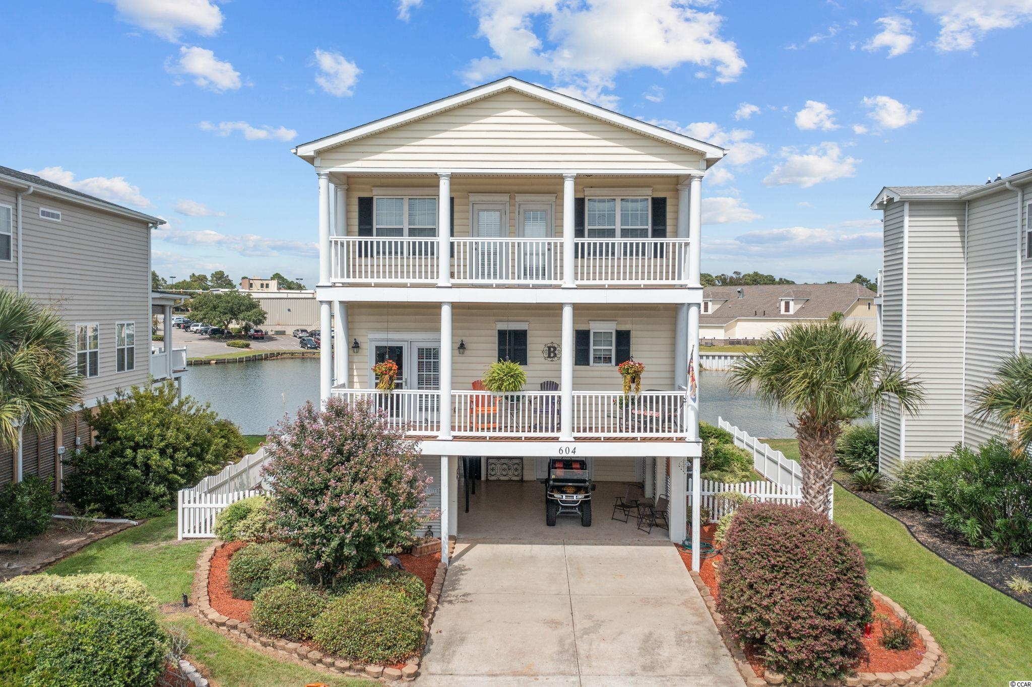 Beautiful home in the heart of North Myrtle Beach. FURNITURE IS NEGOTIABLE. Turnkey and ready to move in, just one block from Main Street. Being located in the Ocean Drive section of North Myrtle makes this home ideal for either a vacation home or primary residence. The home has an open floor plan with a large kitchen that includes stainless steel appliances and tiled flooring which joins the dining and living area that features hardwood floors throughout home.  The main floor also features a balcony that runs the entire length of the front of the home. Your master suite has large walk-in closet, and the bath features a garden tub, shower and tiled floors. The master bedroom opens up to a large deck that runs the full length of the second floor and overlooks water behind the home. The top floor also includes two additional large bedrooms and a full bath. Both of these bedrooms have access to a balcony. No HOA Association and No HOA DUES!