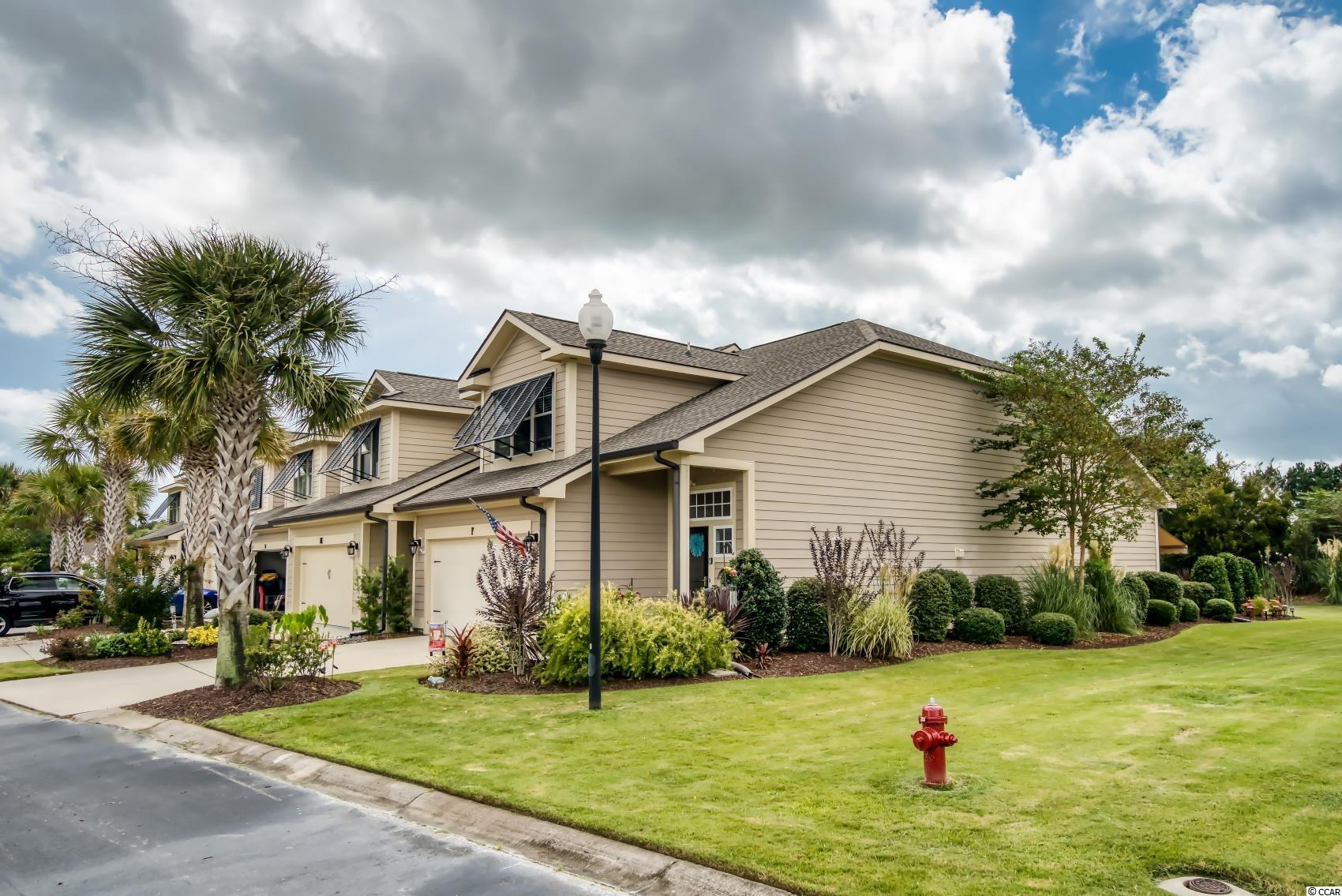 Parmelee is located in Murrells Inlet, just 5 minutes to the historic Marsh Walk, numerous grocery stores, and shopping. Excellent, 3BR 2.5 BA End unit townhome. This unit includes a new roof, HVAC, handler and all new garage door mechanics, which were installed in 2021. All warranties are transferable to the new owner. Primary Suite located on the 1st Floor with a large walk-in closet, and an ensuite bath with double vanity, garden tub, separate shower and linen closet. Entrance leads to an airy foyer with tall ceilings. The foyer, off the main living area, also hosts a conveniently located half bath.  Luxury plank flooring flows throughout, with carpet only on the staircase. The kitchen has two spacious breakfast bars, LG Stainless appliances, gorgeous granite counters, honey colored cabinets and double stainless sink. The kitchen also offers extra recessed lighting, a pantry, along with a large laundry room with shelving that houses a Front Load Samsung washer & dryer that conveys. This open concept design has a soaring ceiling that opens up to a second story loft area and allows for socializing from the kitchen, dining, and living area. The carpeted staircase with spindles, gives an elegant touch to this home and leads upstairs to a spacious open office or second living area. The upstairs also contains two large bedrooms with walk in closets that share a full bath. There is also a second laundry/storage room. Pull down steps to attic with storage and two additional lighted storage closets are ready to accommodate. Upgraded ceiling fans in every bedroom and living area with matching custom light fixtures throughout this fine home. The incredible 2 car garage is crowned with a wall of NewAge lockable metal cabinetry that conveys. It also has custom paint, two ceiling fans, and high end epoxy finished floors. Exit into the back patio area with a gorgeous decorative and etched concrete, as you sit under a brand new eclipse awning with sunsetter. Don't miss out on th