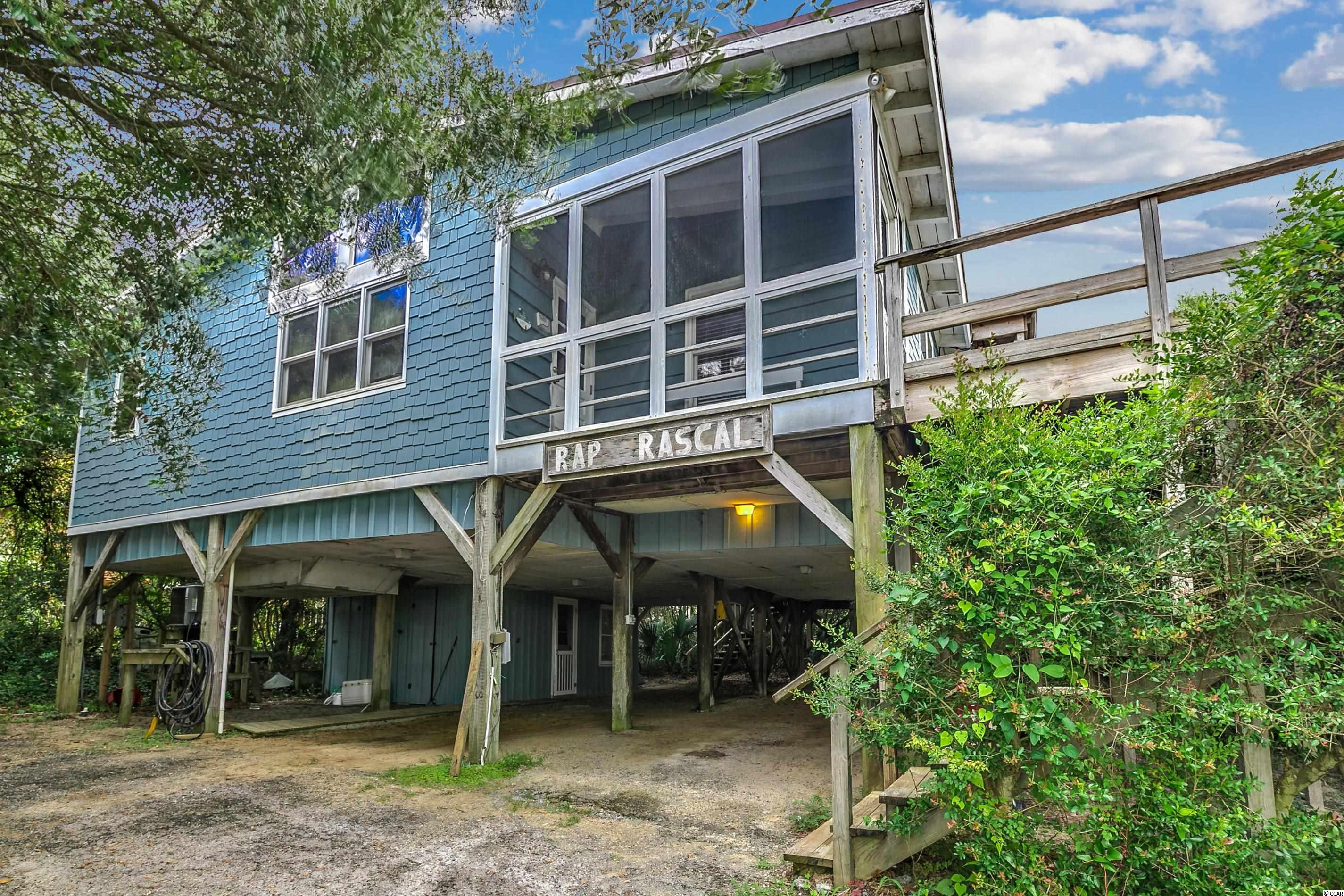 """The """"Rap Rascal"""", appropriately named for an """"arrogantly shabby"""" home...is not just resting on Pawleys Island, but also on the oceanfront AND creekfront, WITHIN the Island's Historic District. History abounds all over Pawleys, but none more than this center Island location, a place between the two Causeways, where proposals are offered, teenagers frolic each year during the Summer's """"first week at the beach"""", Fourth of July celebrated in style, family gatherings are revered and remembered forever, deep conversations frequent both the creekfront covered dock and the dune walk-over to the beach; and, well, once in a blue moon, there is seen a """"Gray Man"""" walking the beach before a storm. If yours, you will not hesitate to talk about Pawleys to all you know. You will be proud, and at the same time, you will claim the Island as yours. As soon as the word gets out of your new purchase, your friend-group will explode. So come take a peek. """"Rap Rascal"""" is really a cool place. There's absolutely nothing like Pawleys.  NOTHING."""