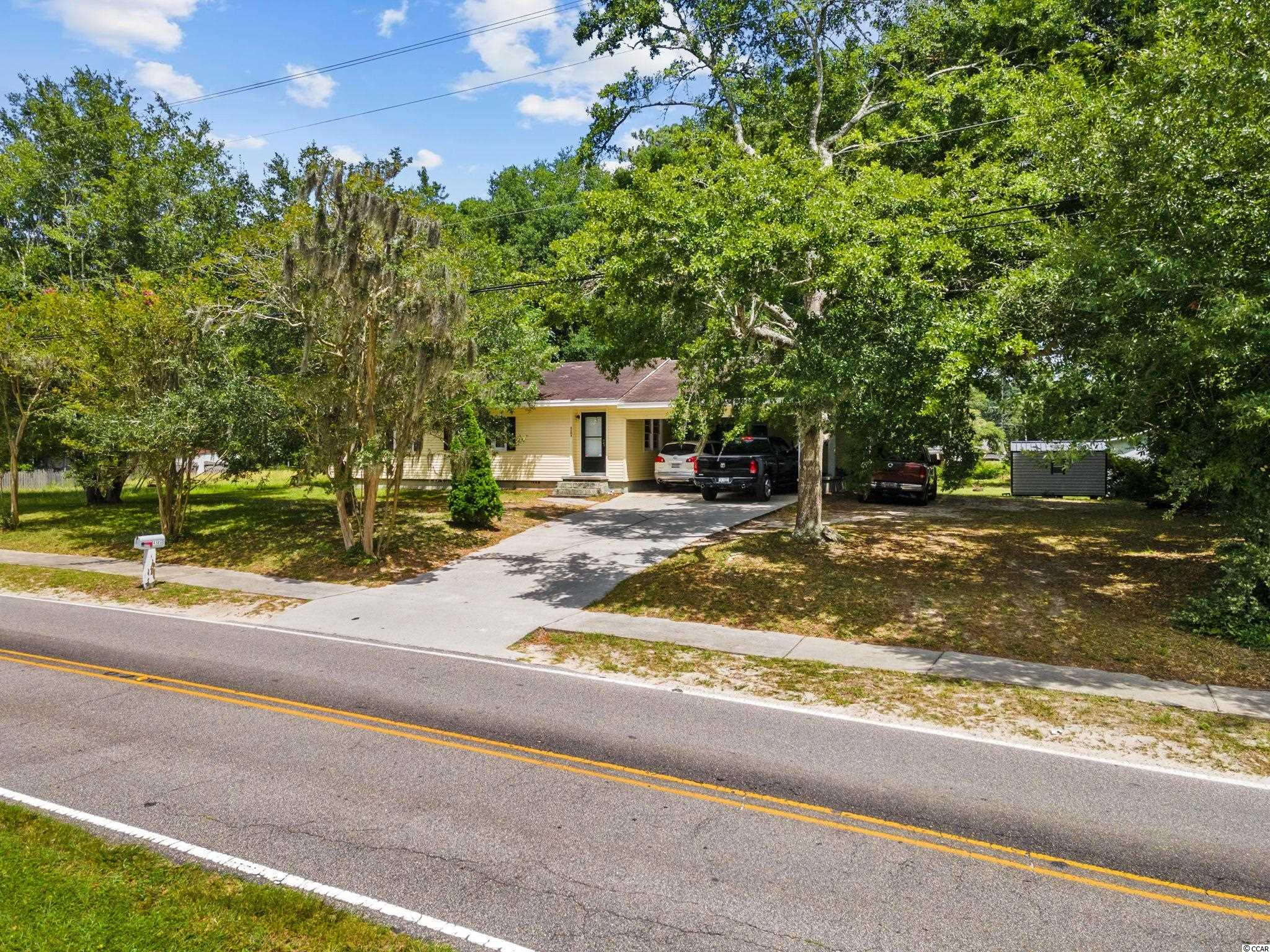 Rare opportunity located in Little River SC! NO HOA! East of 17 ! Close to the Beach and Golf! Adorable cottage style 3 bedroom 2 bath home on a .41 ac lot. Just a Golf Cart Ride or Walk from the ICW, Casino Boats, and all the local hotspots . Hang out on your newly built 2021 wooden deck in your back yard shaded under the Oak Tree. You will appreciate this great size lot to park your Guests, RV , Motorcycles, Room to build a shed and Maybe install a pool. This home has an attached 2 car carport, hardwood floors, freshly painted walls, and a screened in breeze way to your laundry room . Located only 3.3 miles to Calabash NC , 5.8 mile to Cherry Grove North Myrtle Beach , 7.3 miles to Sunset Beach NC, 30.5 miles to Myrtle Beach Airport , and 54.4 miles to Wilmington Airport NC. Home is to be purchase AS IS Where IS
