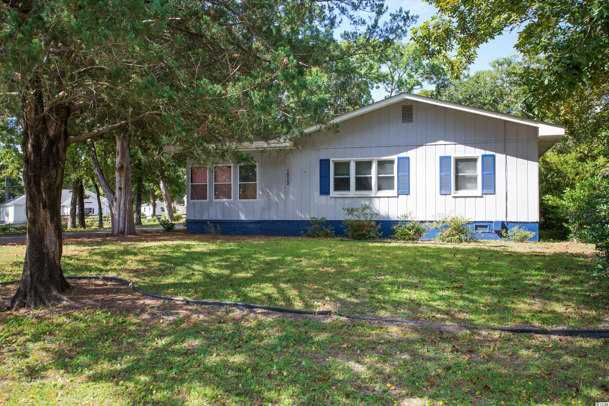 Great location in North Myrtle Beach east of 17.  Large .36 acres on high ground.  3 Bedrooms, 2.5 Baths.  Home needs some work and due to some rotten wood in the window sills, most likely would not pass a CL-100.  All offers would need to be cash.  Owners are selling as is.  Features a 2-car garage and a workshop in back.  HVAC replaced in 2018.